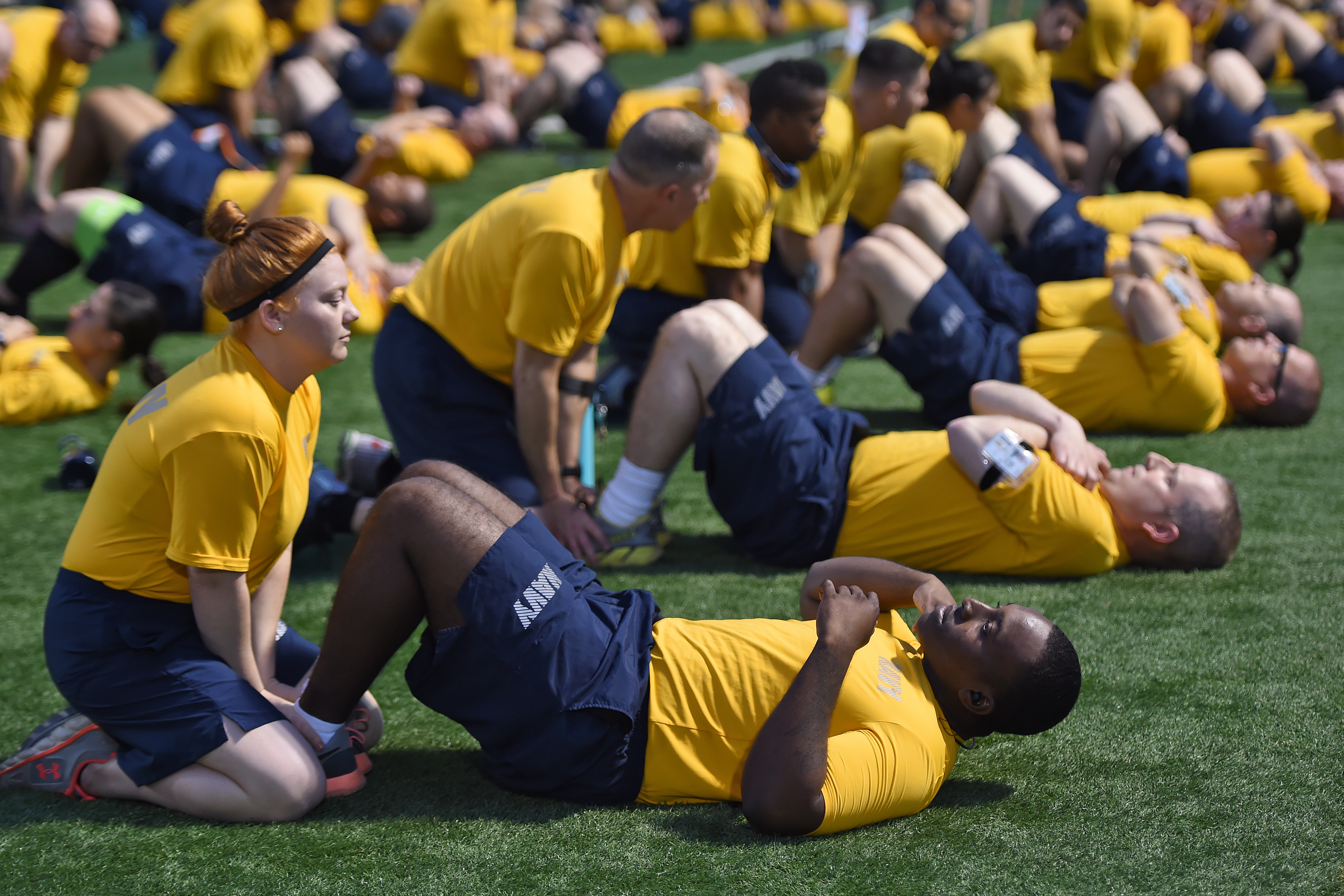 U.S. Sailors assigned to Combined Joint Task Force-Horn of Africa prepare to perform two minutes of curl-ups during a practice physical fitness test at Camp Lemonnier, Djibouti, Feb. 24, 2017. The trial assessment  gave Sailors an opportunity to test their physical readiness prior to the April implementation of the Navy Physical Fitness Assessment program, from which they were previously exempted. (U.S. Air National Guard photo by Master Sgt. Paul Gorman)