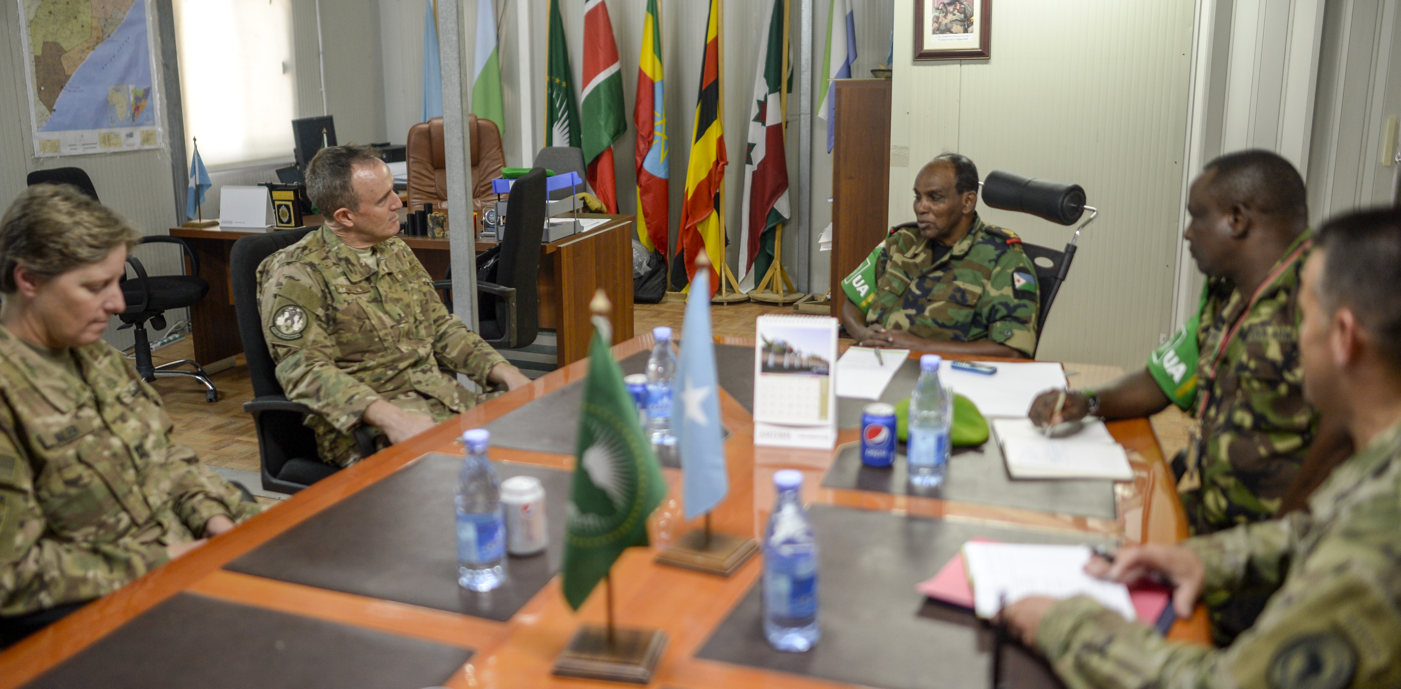 U.S. Air Force Brig. Gen. Phil Purcell, Combined Joint Task Force-Horn of Africa (CJTF-HOA) deputy commander, discusses the current status of Somalia with Djibouti Armed Forces Lt. Gen. Osman Noor Soubagleh, force commander of the African Union Mission in Somalia (AMISOM), and other key members of AMISOM, in Mogadishu, Somalia Mar. 15, 2017.  The meeting helped to coordinate CJTF-HOA, the United Nations, European Union, the AMISOM and other international partner's efforts to stabilize Somalia and the surrounding regions. (U.S. Air National Guard photo by Christian M. Jadot)
