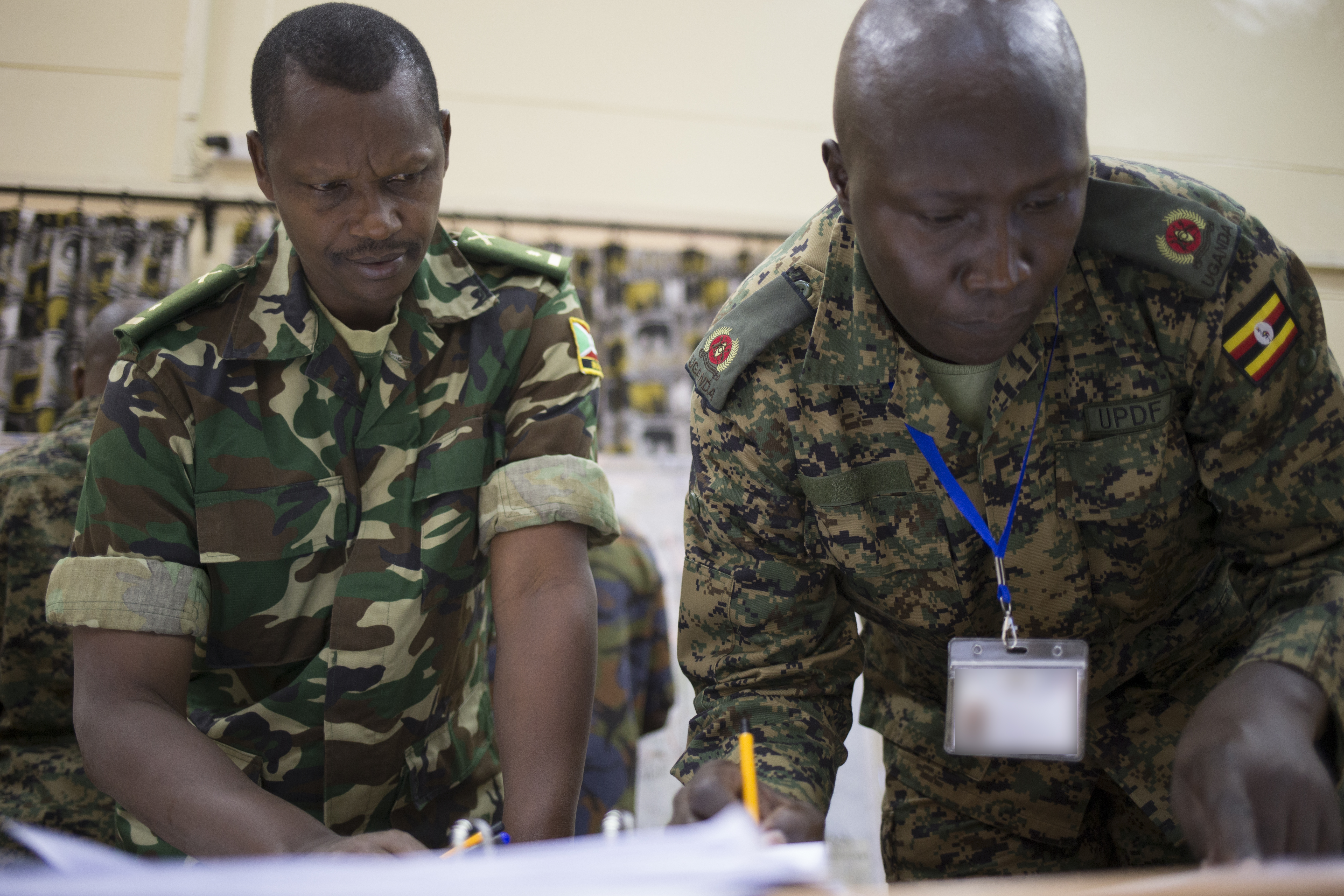 Staff officers from the Burundi National Defense Force and Uganda People's Defense Force work together to plan and coordinate responses to simulated events during the command post exercise of the Africa Contingency Operations Training and Assistance force headquarters training program held at the Humanitarian Peace Support School in Nairobi, Kenya, March 9, 2017.  The five-week course was facilitated by the U.S. Department of State and is designed to improve Africa's military capabilities by providing selected training necessary for multinational peace support operations. (U.S. Army photo by Capt. Alán Ortiz)