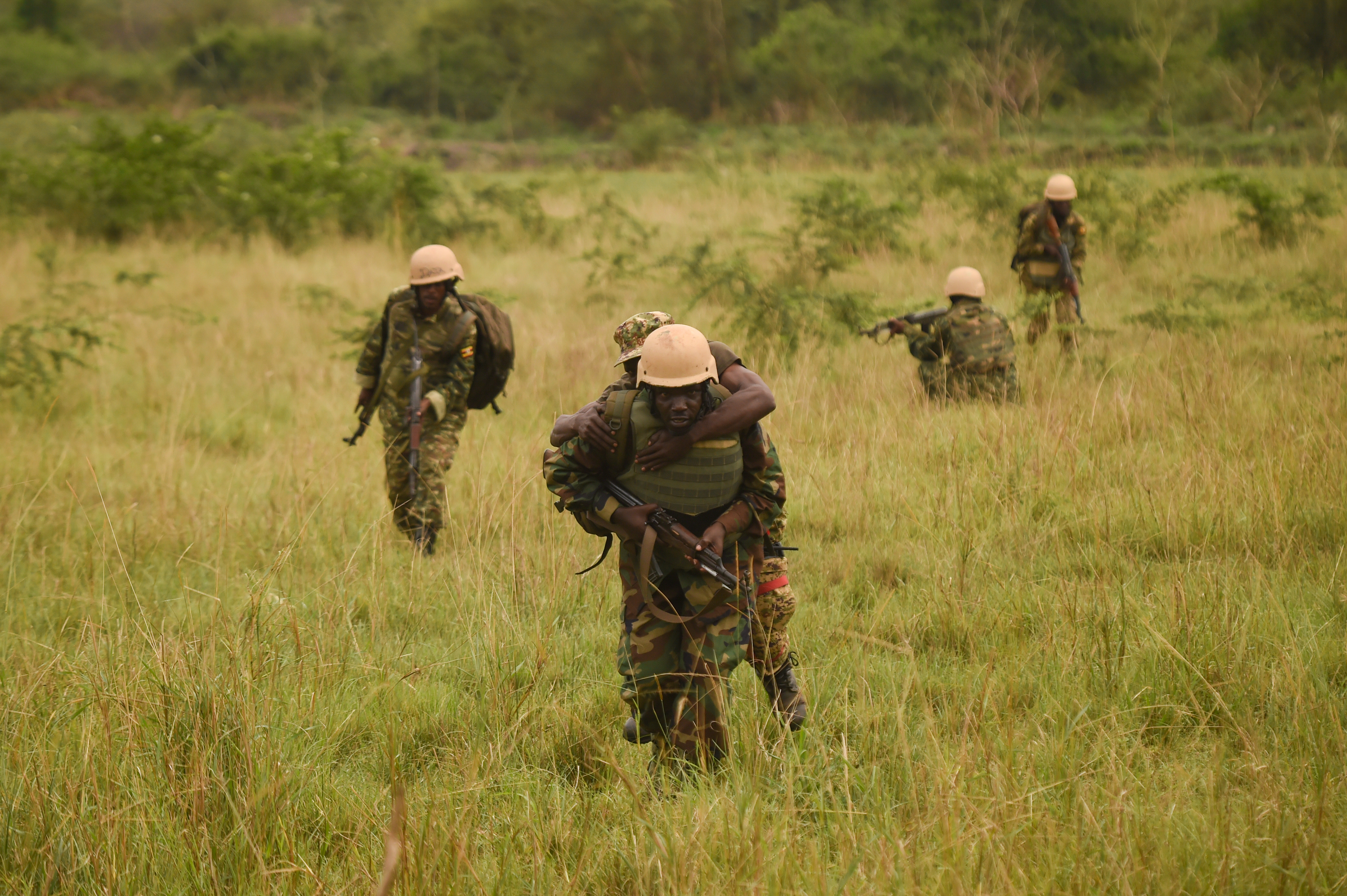 A Uganda People's Defense Force (UPDF) soldier with Ugandan Battle Group 22, carries a simulated casualty to a safer location during a medical exercise at Camp Singo, Uganda, March 3, 2017. Up to 25 percent of deaths on the battlefield are preventable. Administering swift medical attention on the battlefield and in transport greatly improves the survival rate of casualties. (U.S. Air National Guard photo by Staff Sgt. Penny Snoozy)