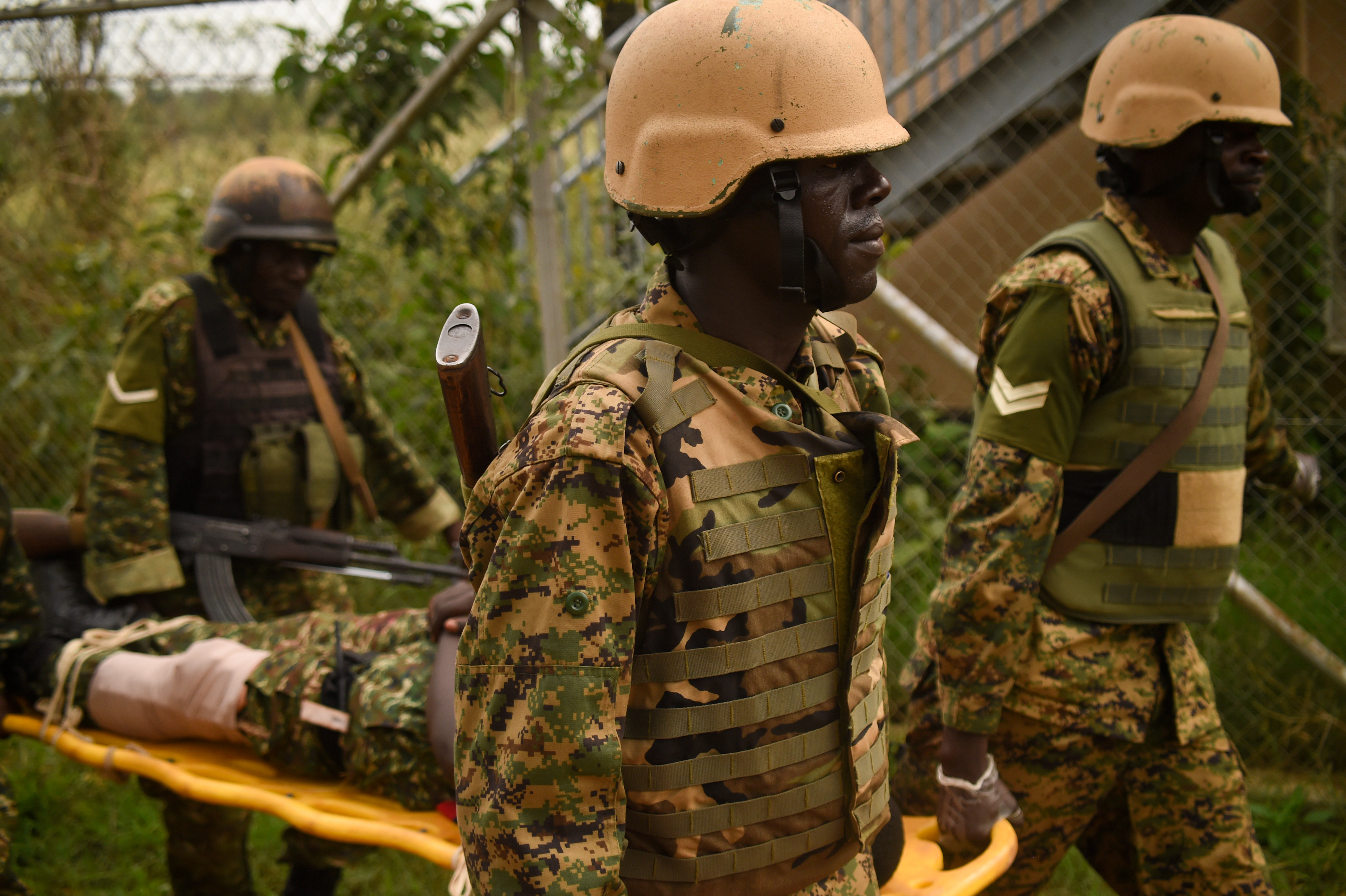 Uganda People's Defense Force (UPDF) soldiers with Ugandan Battle Group 22, transport a simulated casualty to an extraction point during a medical exercise at Camp Singo, Uganda, March 3, 2017. Up to 25 percent of deaths on the battlefield are preventable. Administering swift medical attention on the battlefield and in transport greatly improves the survival rate of casualties. (U.S. Air National Guard photo by Staff Sgt. Penny Snoozy)