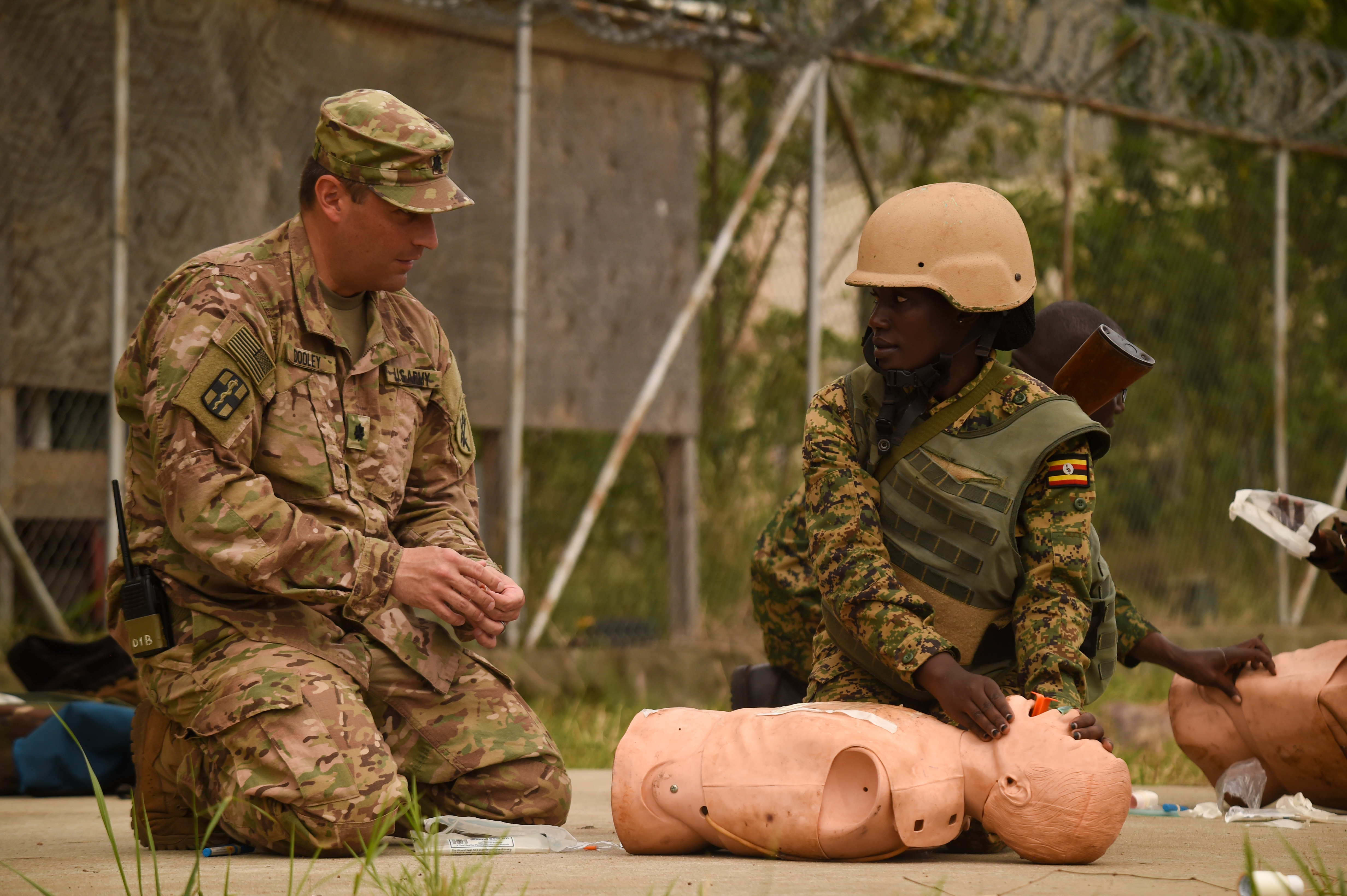 U.S. Army Lt. Col. Sean Dooley, functional specialty team officer in charge with Combined Joint Task Force-Horn of Africa's 418th Civil Affairs Battalion, oversees a Uganda People's Defense Force (UPDF) soldier assigned to Ugandan Battle Group 22 (UGABAG 22), providing and maintaining an open airway during a medical exercise at Camp Singo, March 3, 2017. The UPDF's UGABAG 22 tested the skills they culminated earlier in their pre-deployment training such as nine-line medical evacuation, combat lifesaving techniques, and providing cover from an enemy during extractions. (U.S. Air National Guard photo by Staff Sgt. Penny Snoozy)