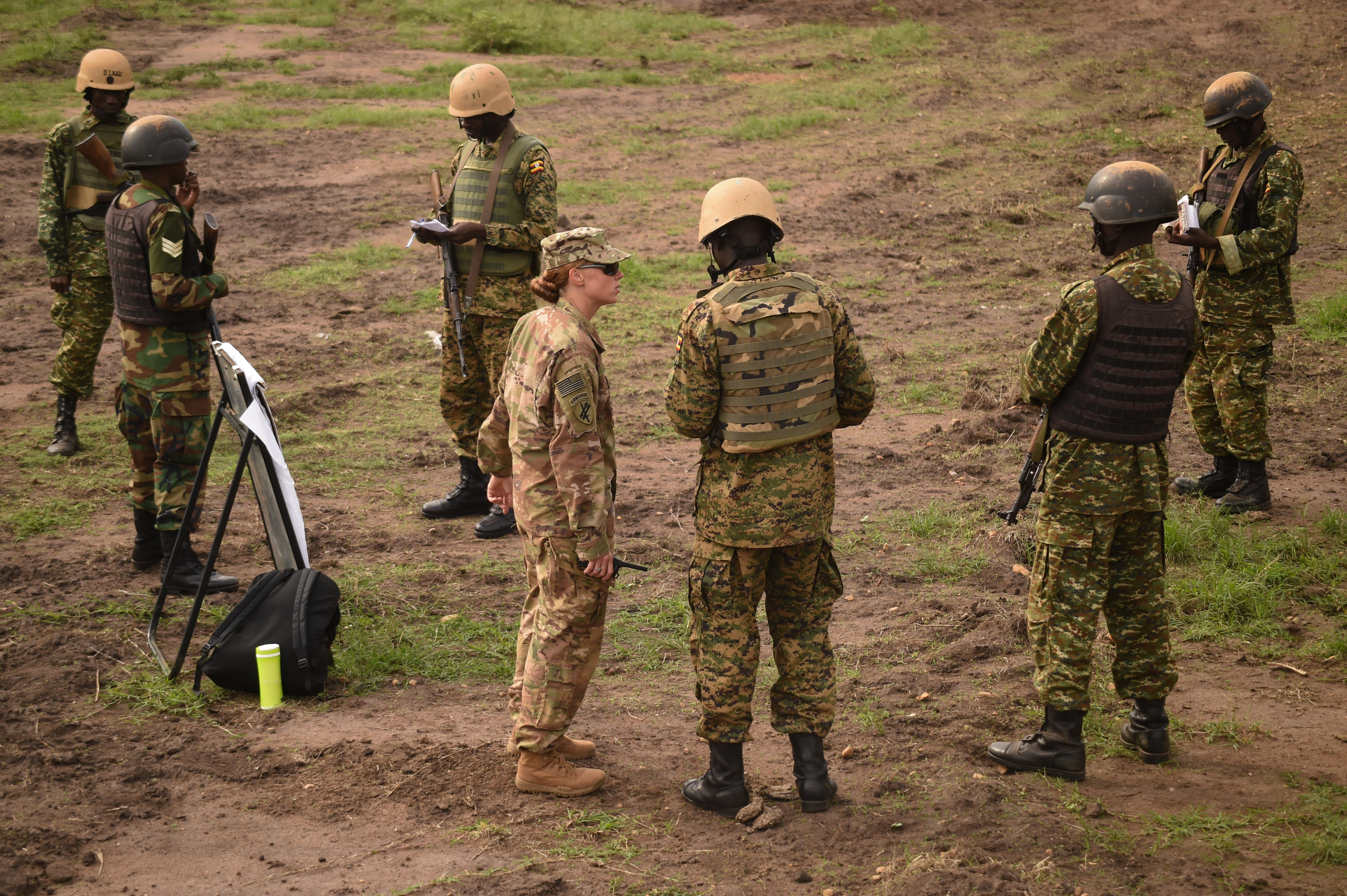 U.S. Army Sgt. Sarah DeArcy with Combined Joint Task Force-Horn of Africa's (CJTF-HOA) 411th Civil Affairs Battalion, listens to a nine-line medical evacuation request from a Uganda People's Defense Force (UPDF) soldier assigned to Ugandan Battle Group 22, during a medical exercise at Camp Singo, Uganda, March 3, 2017. During a 9 Line Medevac, the soldier reports details including the patient's location, medical condition and extraction site markers. CJTF-HOA members supplemented the training as the UPDF instructors become self-sufficient in their predeployment preparation. (U.S. Air National Guard photo by Staff Sgt. Penny Snoozy)