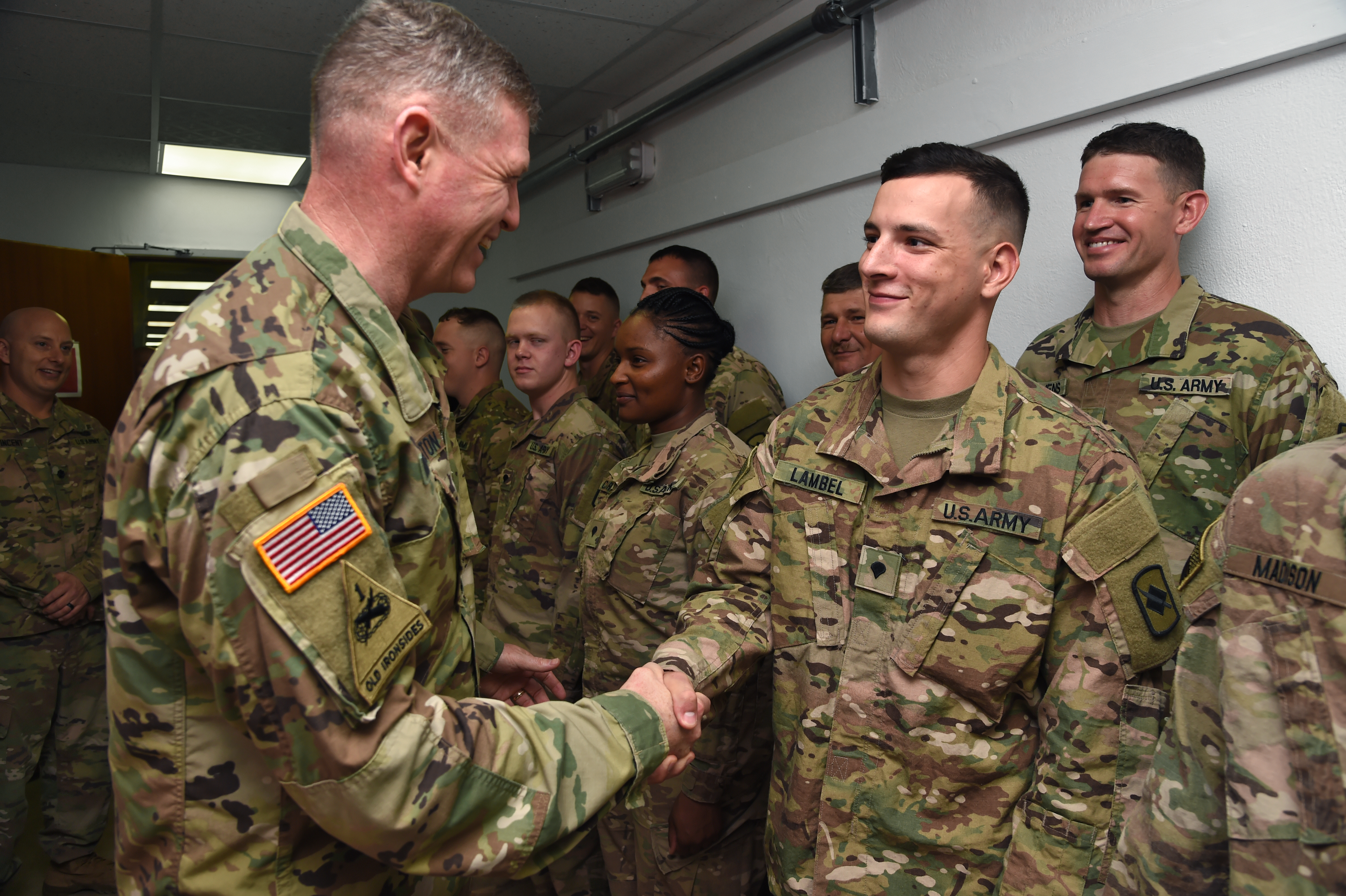 U.S. Army Maj. Gen. Joseph Harrington, commanding general of U.S. Army Africa recognizes Spc. Anthony Lambel for outstanding performance as an infantry team leader for the 1st Battalion, 153rd Infantry Regiment while deployed to Camp Lemonnier, Djibouti, March 22, 2017. Harrington's visit included the opportunity to meet with Camp Lemonnier and Combined Joint Task Force-Horn of Africa leadership, as well as recognize numerous deployed Soldiers identified as superior performers while serving in the Horn of Africa. (U.S. Air National Guard photo by Master Sgt. Paul Gorman)