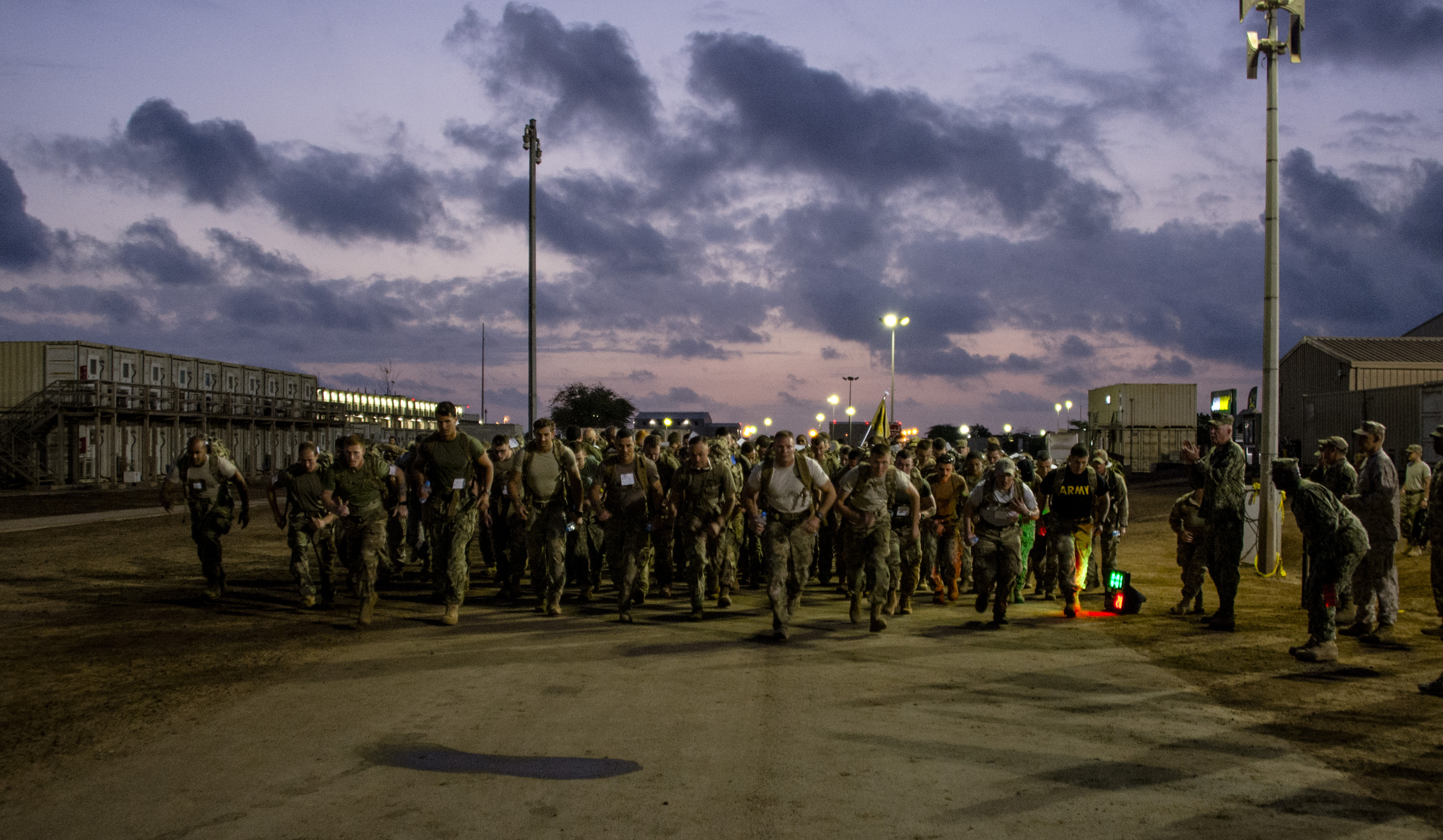Participants of the Joint Warrior Competition (JWC) start the event before sunrise on Camp Lemonnier, Djibouti, March 25, 2017. Camp Lemonnier and Combined Joint Task Force-Horn of Africa senior enlisted leadership designed the JWC as a way to demonstrate joint service understanding, leadership, physical and mental toughness for its participants. (U.S. Air National Guard photo by Staff Sgt. Christian Jadot)