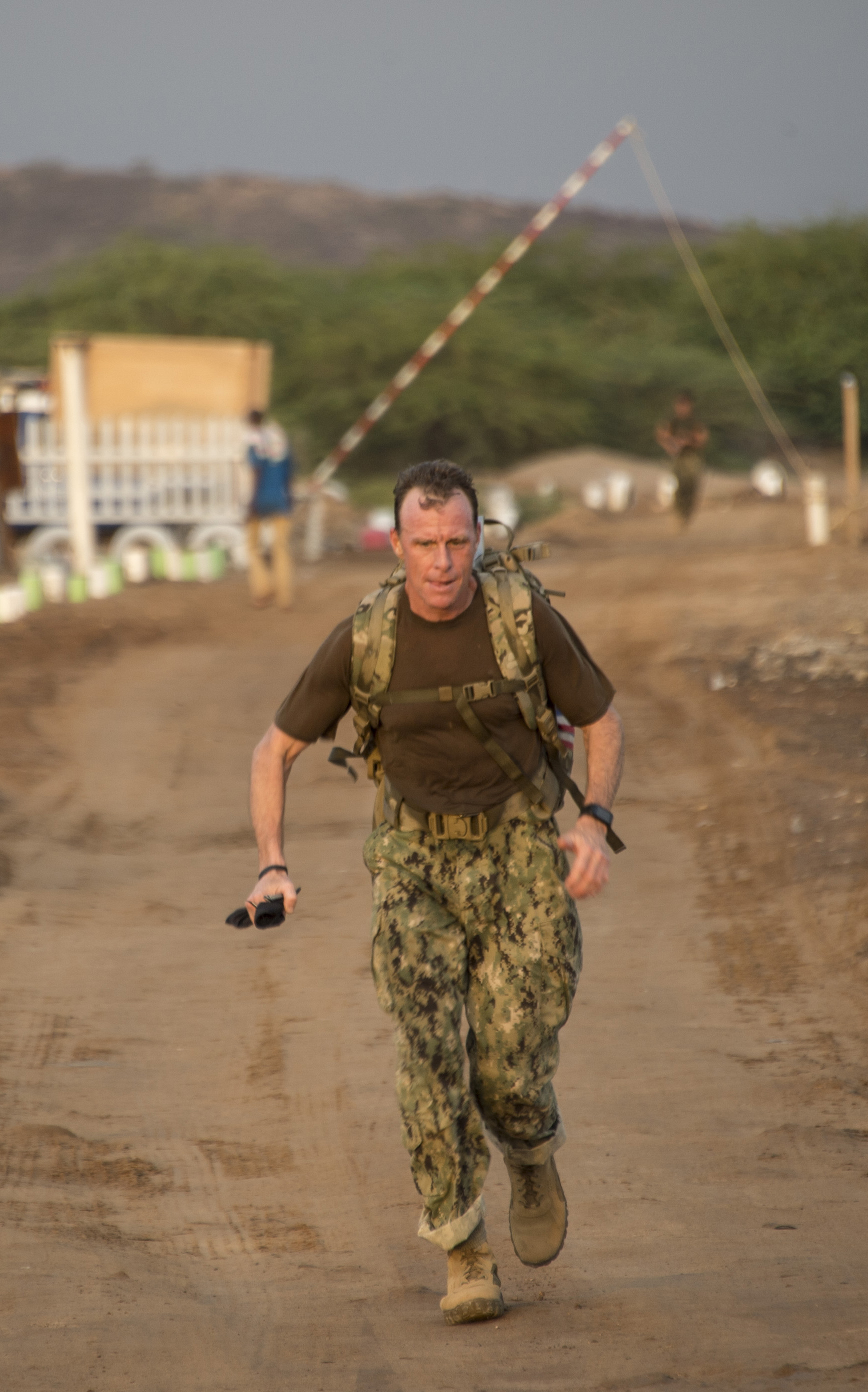 U.S. Navy Command Master Chief Geoffrey Steffee, Combined Joint Task Force-Horn of Africa command senior enlisted leader leads the ruck-march portion of the Joint Warrior Competition (JWC) outside of Camp Lemonnier, Djibouti, March 25, 2017. Steffee was the first person to complete the course. Competitors in the JWC put their physical fitness to the test by competing in 10 separate events designed to challenge their resiliency. (U.S. Air National Guard photo by Staff Sgt. Christian Jadot)
