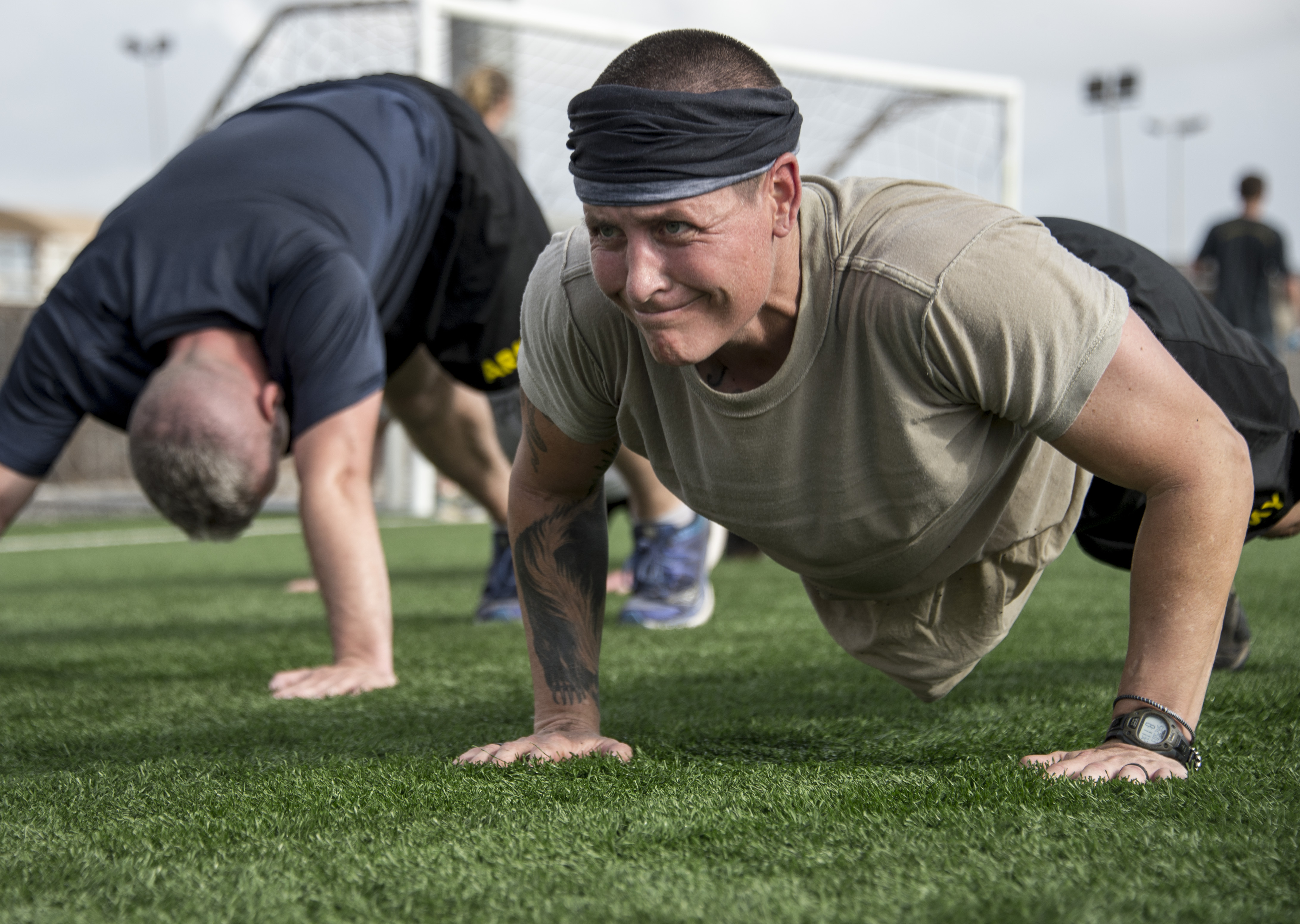 U.S. Army Staff Sgt. Hannah Mabel participates in the push-up portion of the Joint Warrior Competition (JWC) on Camp Lemonnier, Djibouti, March 25, 2017. Participants in the JWC test themselves physically in various events including 50 timed push-ups. (U.S. Air National Guard photo by Staff Sgt. Christian Jadot)