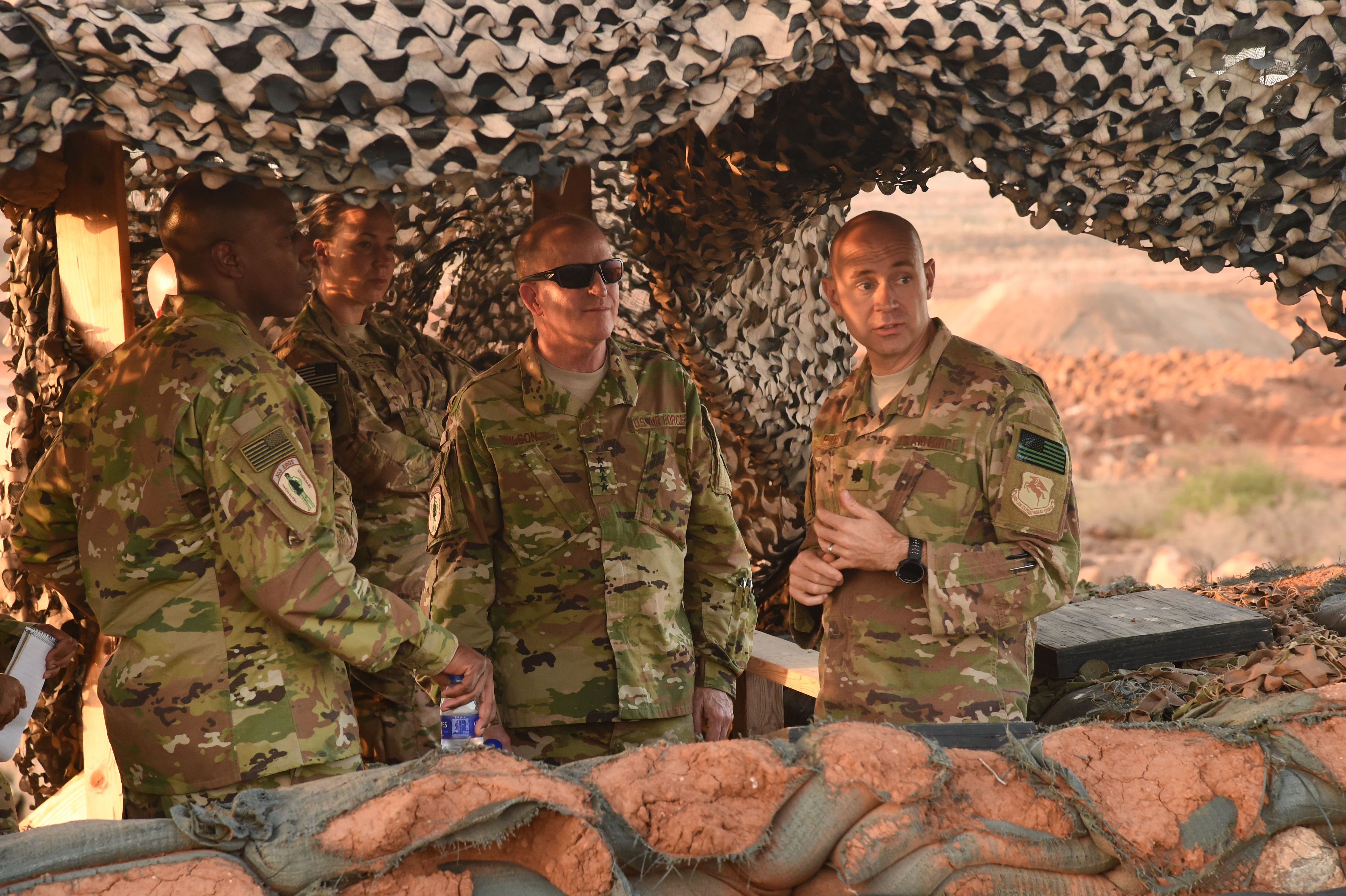 U.S. Air Force Chief Master Sgt. of the Air Force Kaleth Wright and U.S. Air Force Vice Chief of Staff Gen. Stephen Wilson receive a brief from Lt. Col. Joshua Pyers, commander 870th Air Expeditionary Squadron, right, during a visit to an airfield near Camp Lemonnier, Djibouti, April 11, 2017. Wilson visited CJTF-HOA and other tenant commands with Wright to gain a better understanding of Air Force integration and missions in the U.S. Africa Command area of responsibility. (U.S. Air National Guard photo by Staff Sgt. Penny Snoozy)