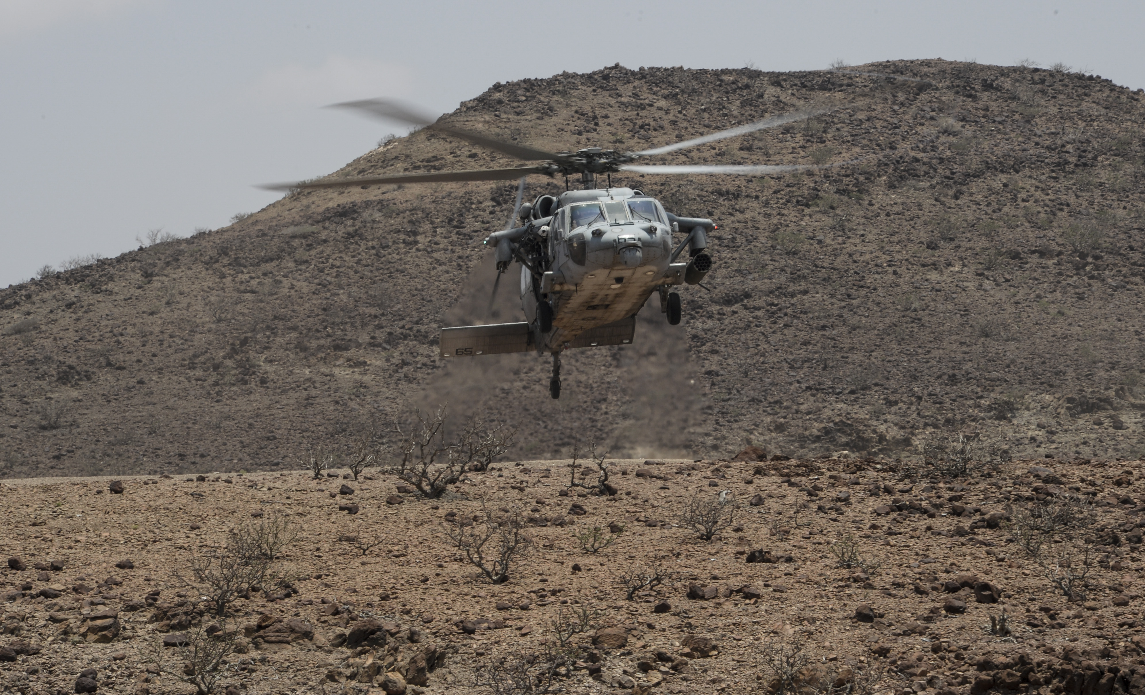 A U.S. Navy SH-60 Seahawk performs a touch-and-go landing during Exercise Alligator Dagger at Arta Range, Djibouti, April 9, 2017. Exercise Alligator Dagger enables the Marines and Sailors to enhance their capabilities and continually support maritime security operations. (U.S. Air National Guard photo by Staff Sgt. Christian Jadot)