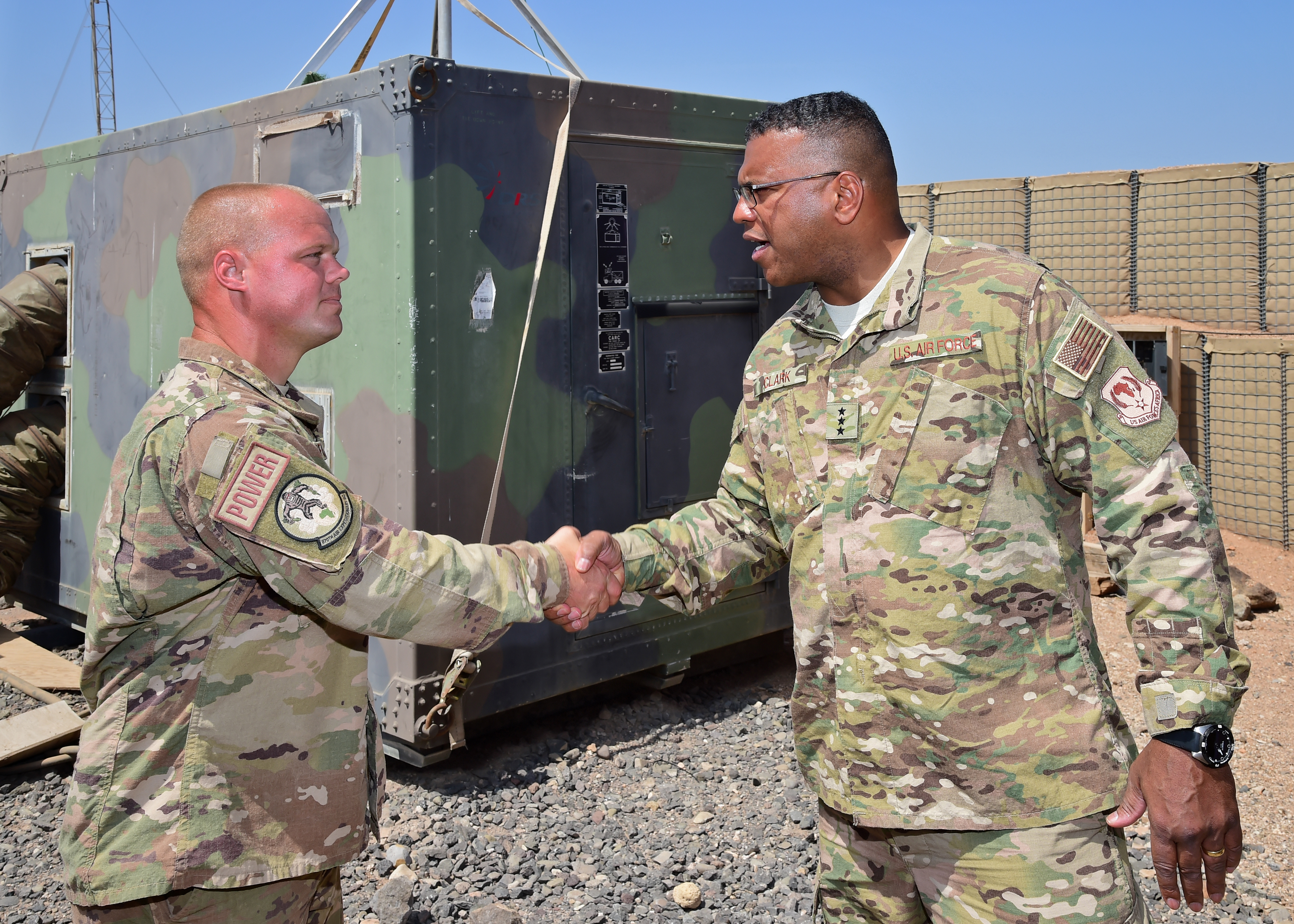 Lt. Gen. Richard Clark, commander of the 3rd Air Force and 17th Expeditionary Air Force, meets Staff Sgt. Daniel Buford, electrical power production specialist for the 870th Air Expeditionary Squadron while visiting an airfield in southern Djibouti, April 12, 2017 to engage with Airman deployed to the installation and surrounding duty stations. The visit allowed Clark and accompanying leadership to gain a better understanding of the Air Force mission in East Africa, and express their appreciation to the many U.S. Airmen deployed throughout the region. (U.S. Air National Guard photo by Master Sgt. Paul Gorman)