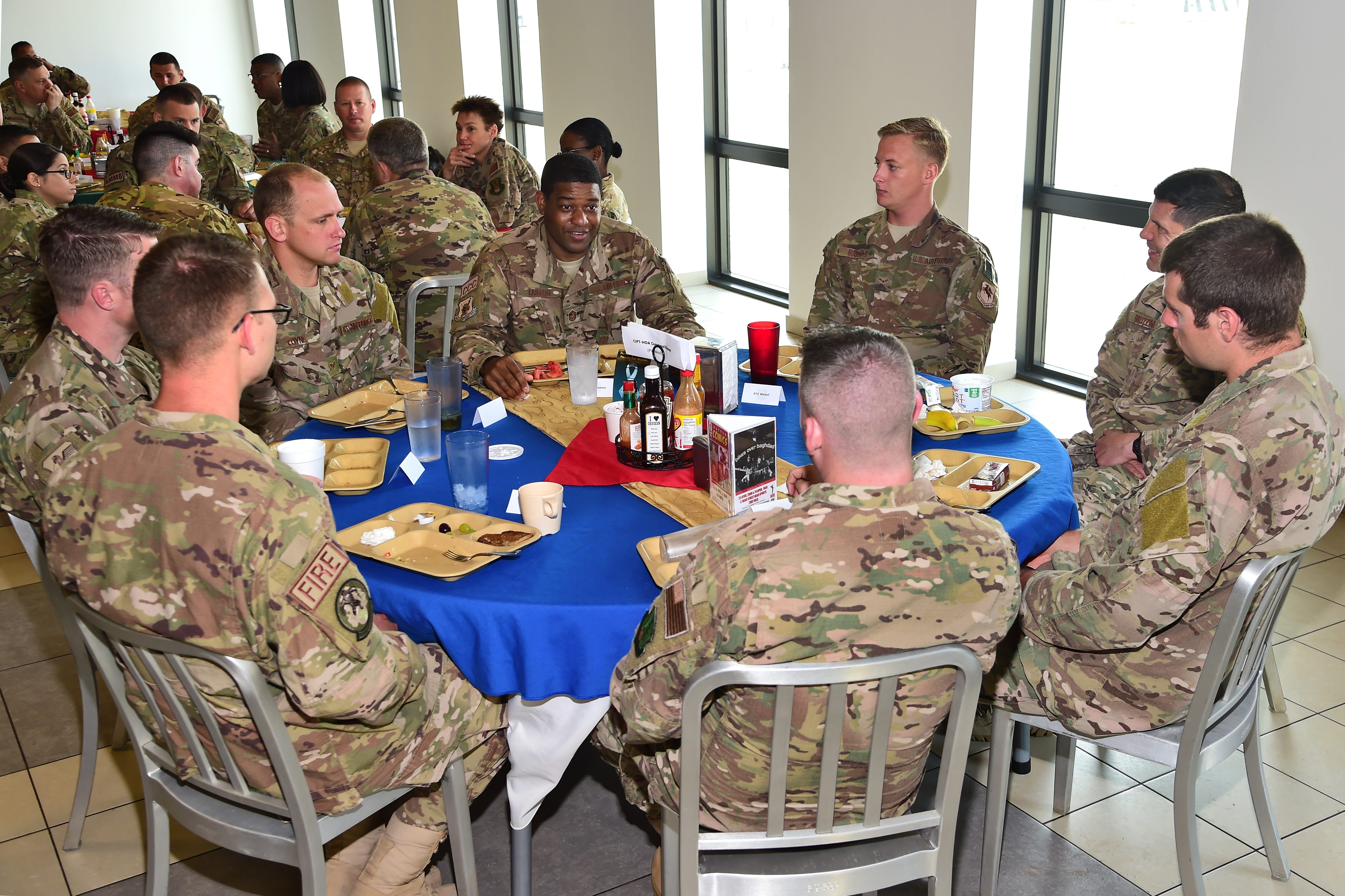 Chief Master Sgt. Phillip Easton, U.S. Air Forces Europe and U.S. Air Forces Africa command chief, engages with active, reserve and National Guard Airmen over breakfast at Camp Lemonnier, Djibouti April 12, 2017. Easton accompanied Lt. Gen. Richard Clark, commander of the 3rd Air Force and 17th Expeditionary Air Force on a visit with deployed Airmen, to gain a better understanding of the Air Force mission in East Africa, and express their appreciation to the many U.S. Airmen deployed throughout the region. (U.S. Air National Guard photo by Master Sgt. Paul Gorman)