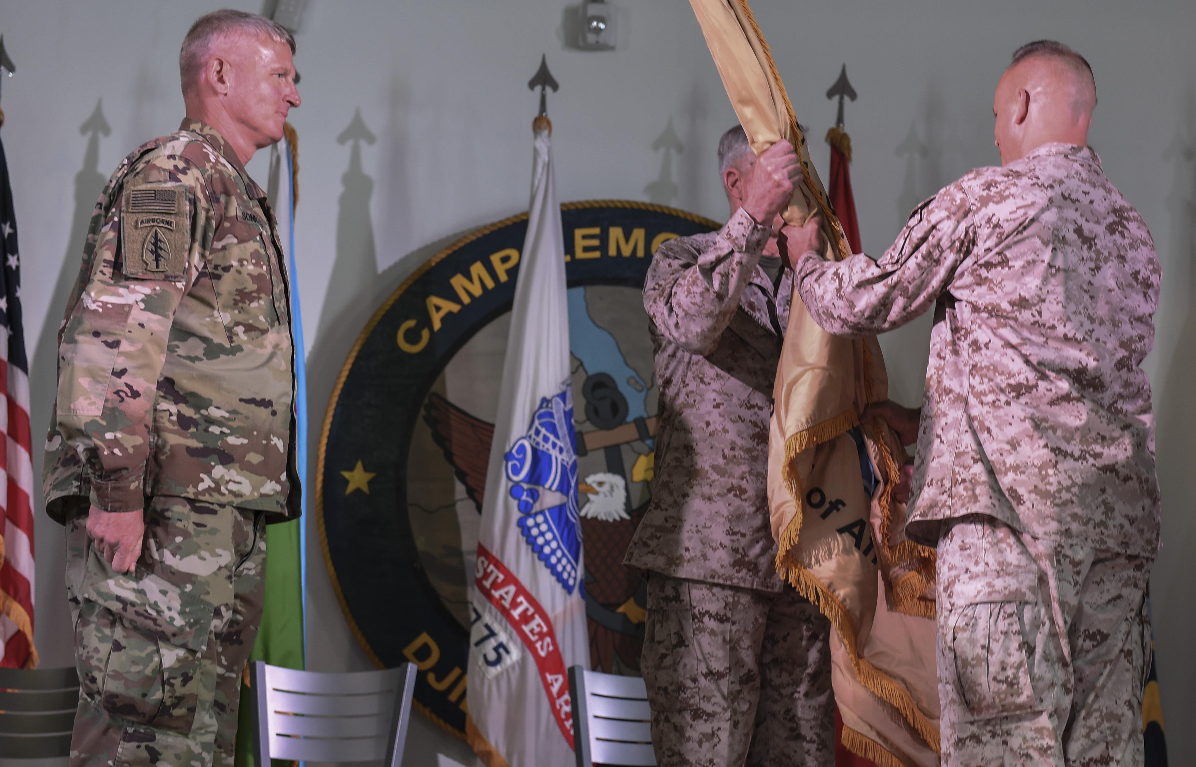U.S. Marine Corps Gen. Thomas Waldhauser, U.S. Africa Command commander, hands the guidon to Brig. Gen. David J. Furness, the incoming Combined Joint Task Force - Horn of Africa commander, during the change of command ceremony on Camp Lemonnier in Djibouti, April 28, 2017. Furness previously served as the legislative assistant to the commandant of the Marine Corps at the Pentagon in Washington D.C. (U.S. Air Force Photo by Eboni Prince)