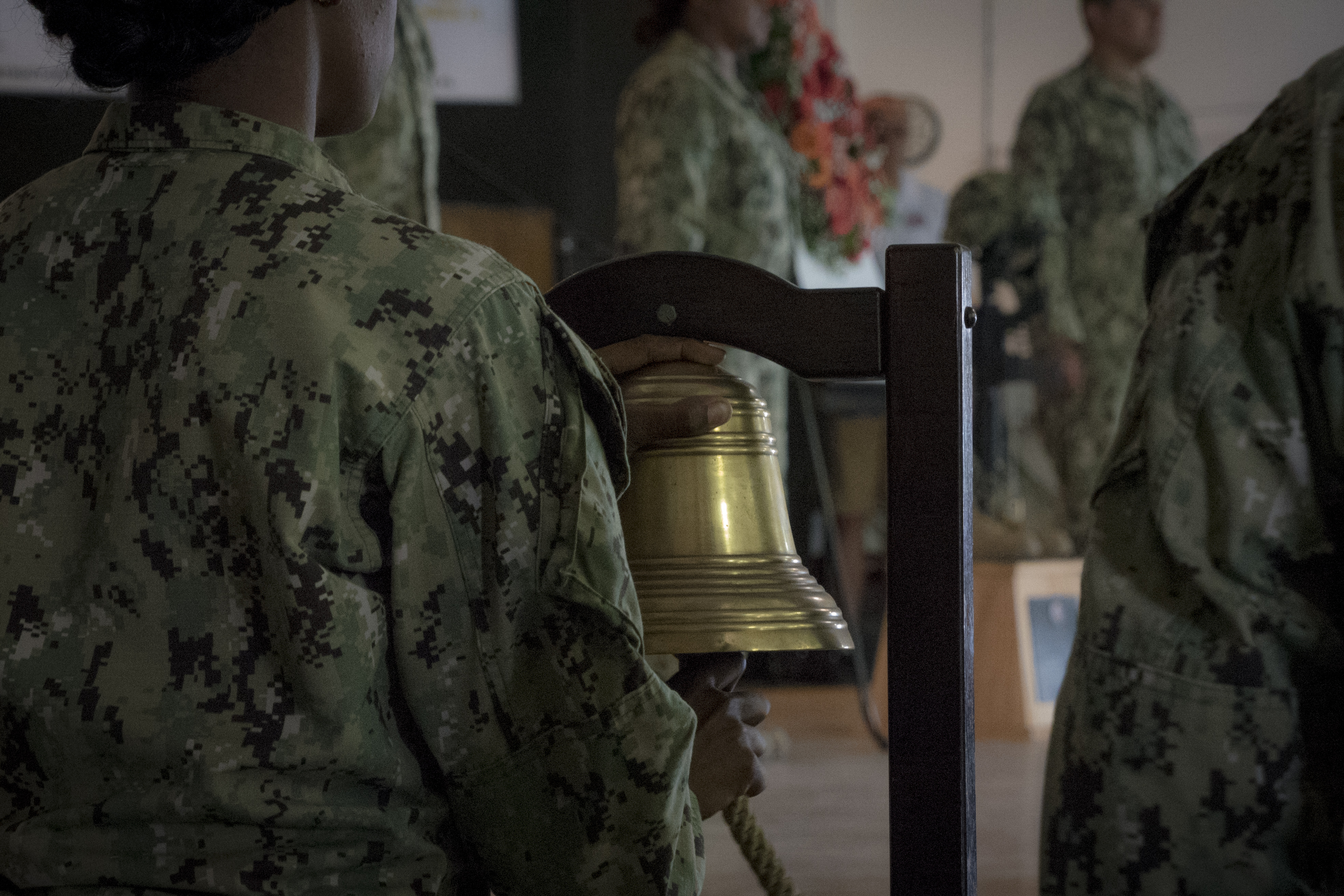 The bell tolls between the names of the fallen as Naval Mobile Construction Battalion One (NMCB-1) of the Combined Joint Task Force-Horn of Africa (CJTF-HOA) Djibouti, are holding a Wreath Laying Memorial Service, May 2, 2017, at Camp Lemonnier, Djibouti. The ceremony is honoring seven Navy Seabees who gave their lives while serving NMCB-14 during Operation Iraqi Freedom on May 2, 2004. In honor of these courageous Seabees and all service members who have made the ultimate sacrifice, the memorial honors and keeps their memories alive. (U.S. Air National Guard photo by Tech. Sgt. Joe Harwood)