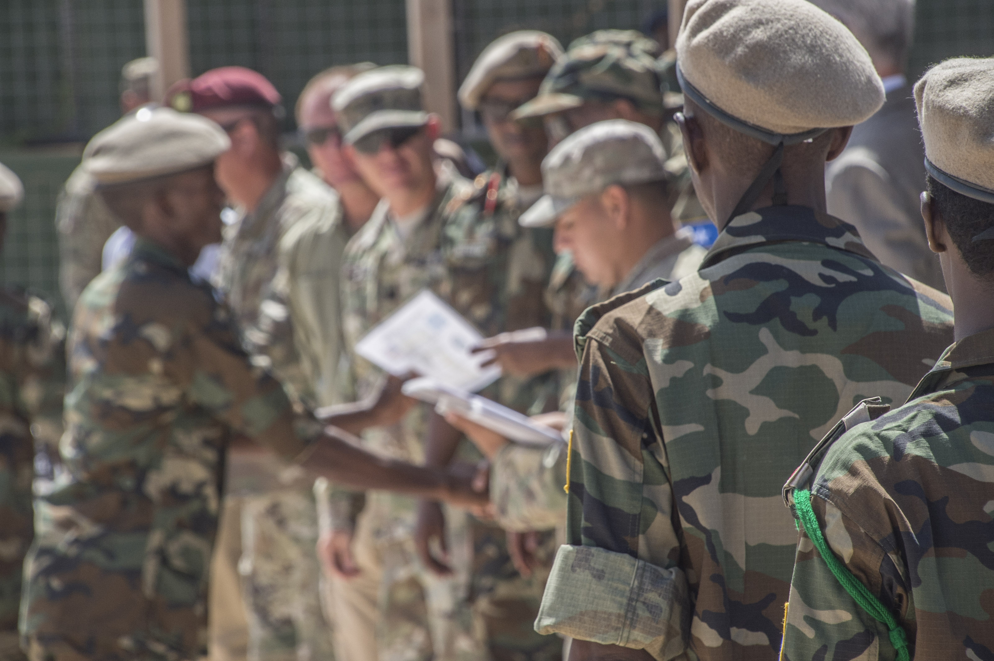 A Somali National Army soldier receives his certificate of completion from a logistics course taught by the U.S. Army's 101st Airborne Division May 24, 2017, in Mogadishu, Somalia. The six-week logistics course focused on various aspects of moving personnel, equipment and supplies. (U.S. Air National Guard photo by Tech. Sgt. Joe Harwood)