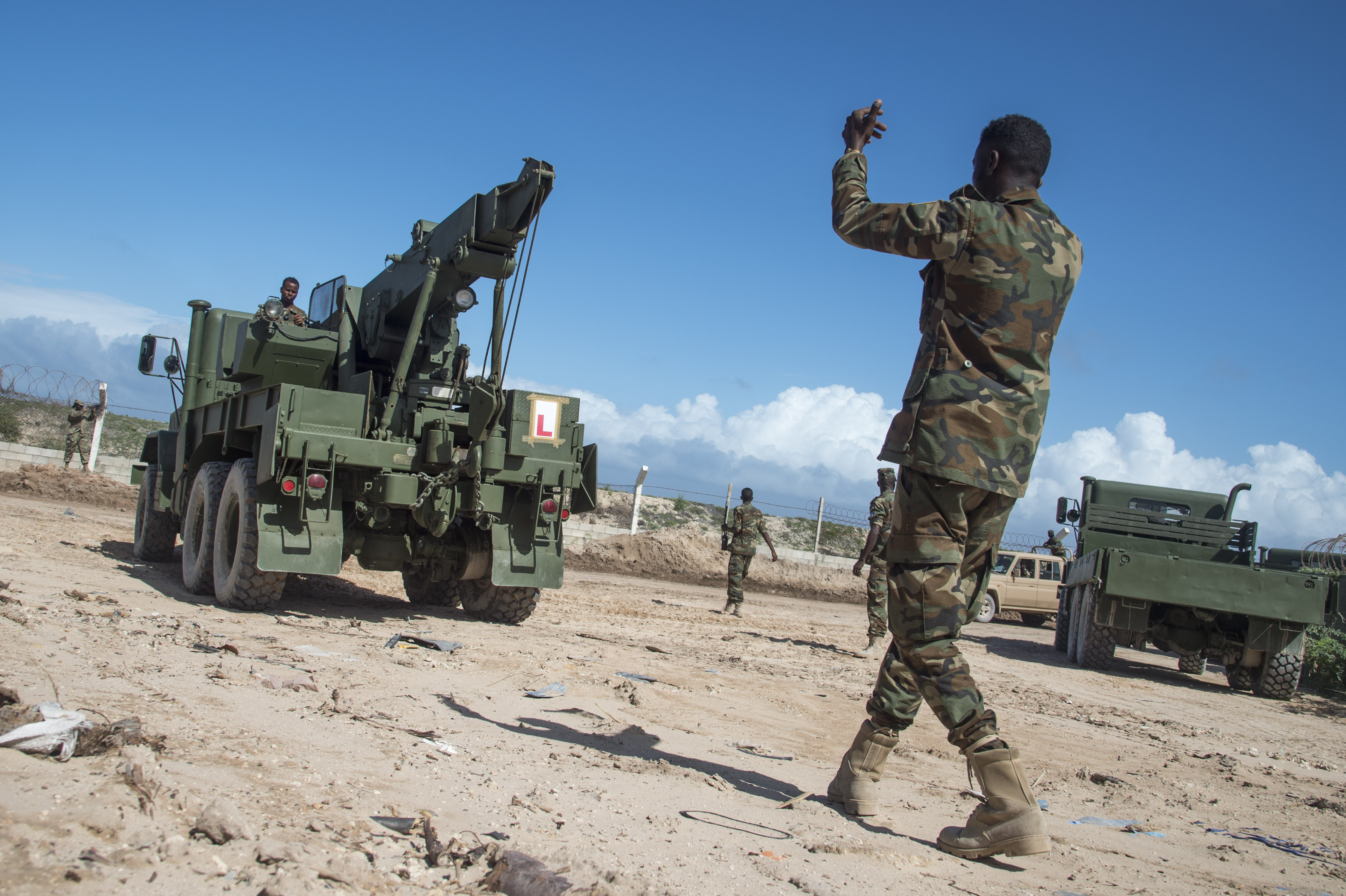 Somali National Army soldiers of the Danab battalion conduct convoy operations training with the U.S. Army's 101st Airborne Division May 22, 2017, in Mogadishu, Somalia. The logistics course focused on various aspects of moving personnel, equipment and supplies. (U.S. Air National Guard photo by Tech. Sgt. Joe Harwood)