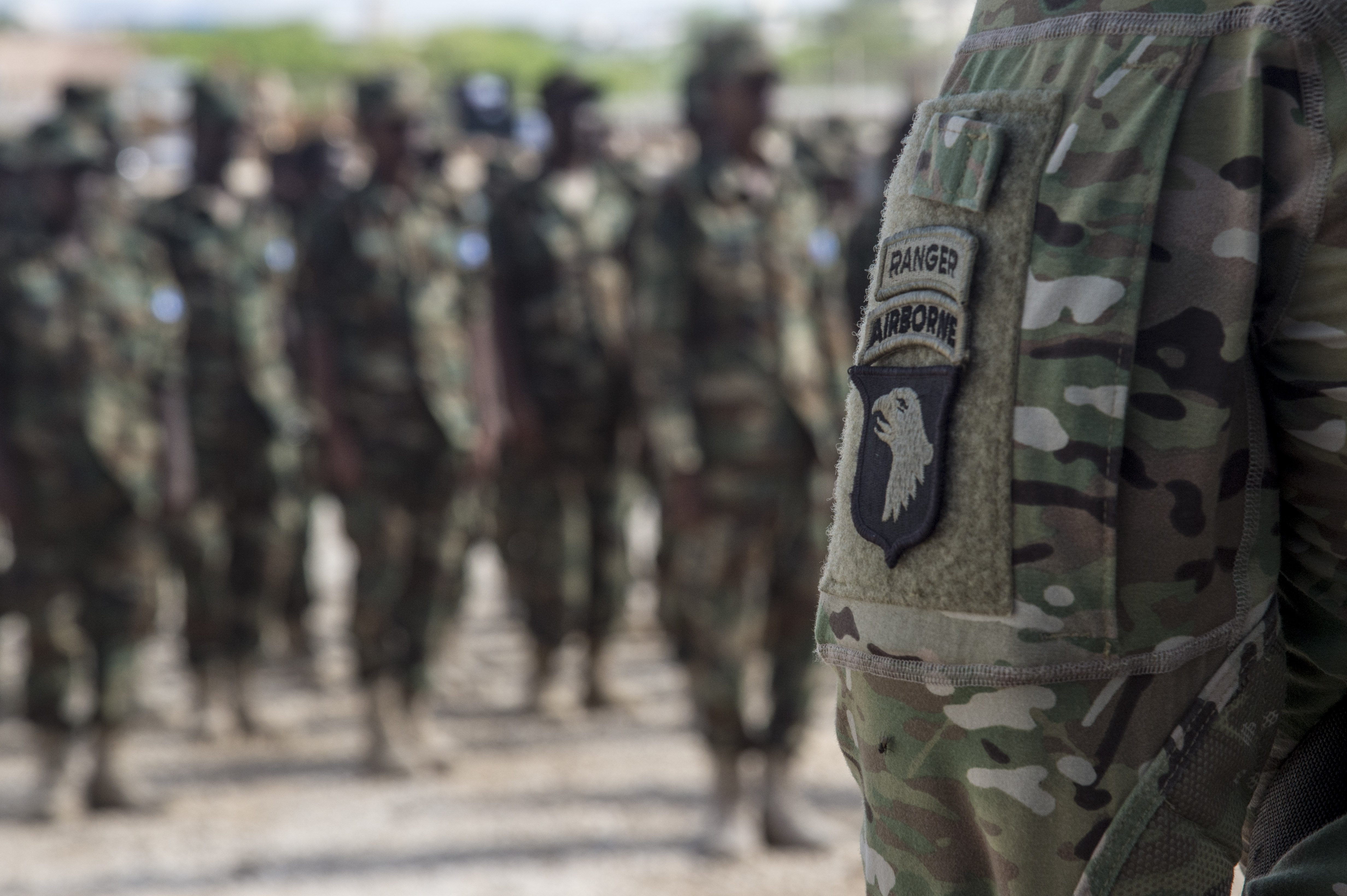 Five U.S. Army 101st Airborne Soldiers deployed with U.S. Army Africa to train Somali National Army soldiers stand at a graduation formation on May 23, 2017, in Mogadishu, Somalia. The six-week logistics course focused on various aspects of moving personnel, equipment and supplies. (U.S. Air National Guard photo by Tech. Sgt. Joe Harwood)