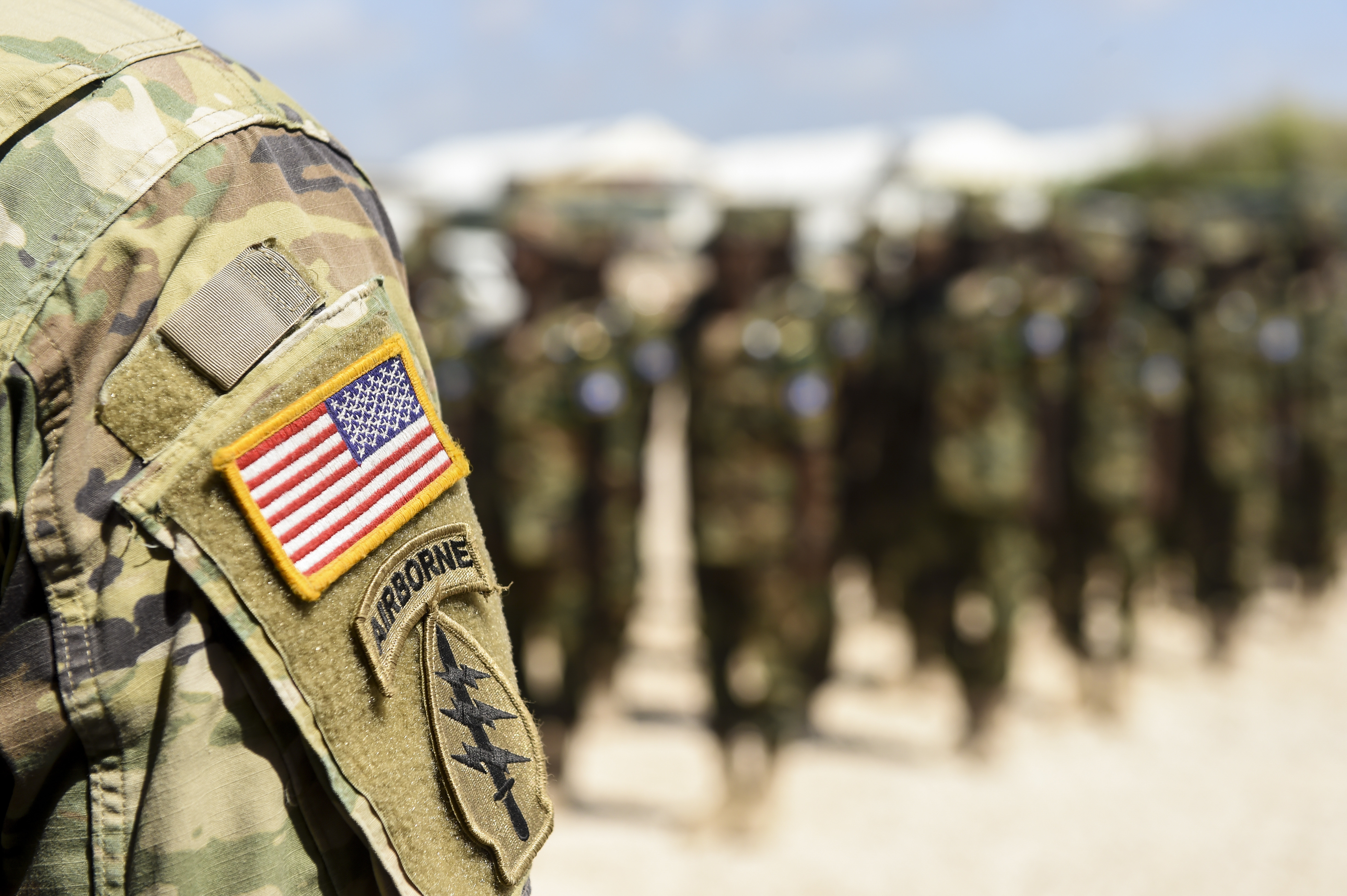 U.S. Army 101st Airborne Division soldiers deployed with U.S. Army Forces Africa stand with Somali National Army soldiers during a graduation ceremony May 24, 2017, in Mogadishu, Somalia. The logistics course focused on various aspects of moving personnel, equipment and supplies. (U.S. Air Force photo by Staff Sgt. Nicholas M. Byers)