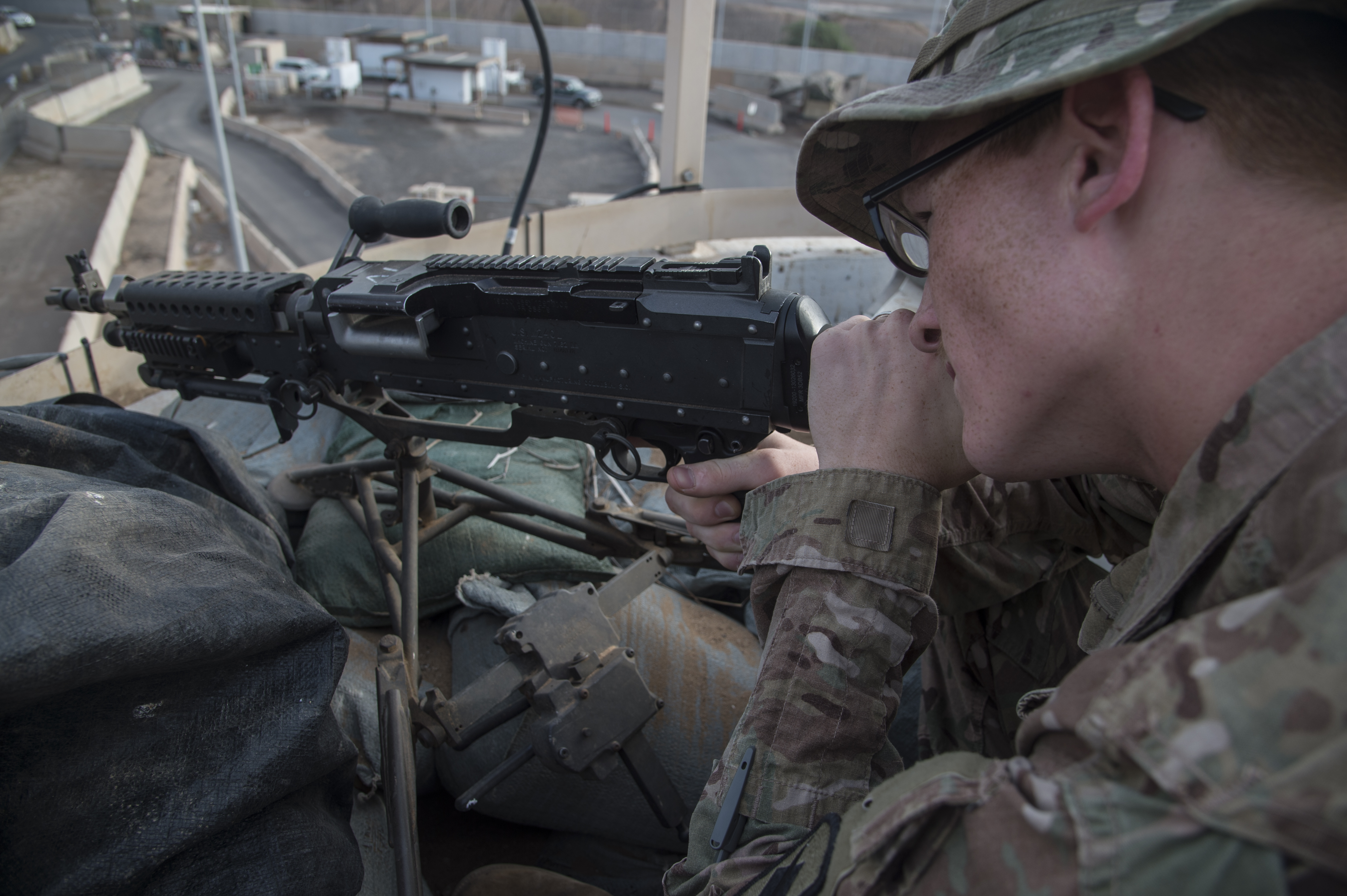 Spc. Britton Boone,1st Battalion, 153rd Infantry Regiment, deployed with the Combined Joint Task Force-Horn of Africa (CJTF-HOA) in Camp Lemonnier, Djibouti, mans the M240 machine gun to secure an entry control point from a base defense tower, June 2, 2017. Soldiers of Alpha company secure the installation 24 hours a day and work with Djiboutian contractors to support efforts in countering regional violent extremist organizations. (U.S. Air National Guard photo by Tech. Sgt. Joe Harwood)