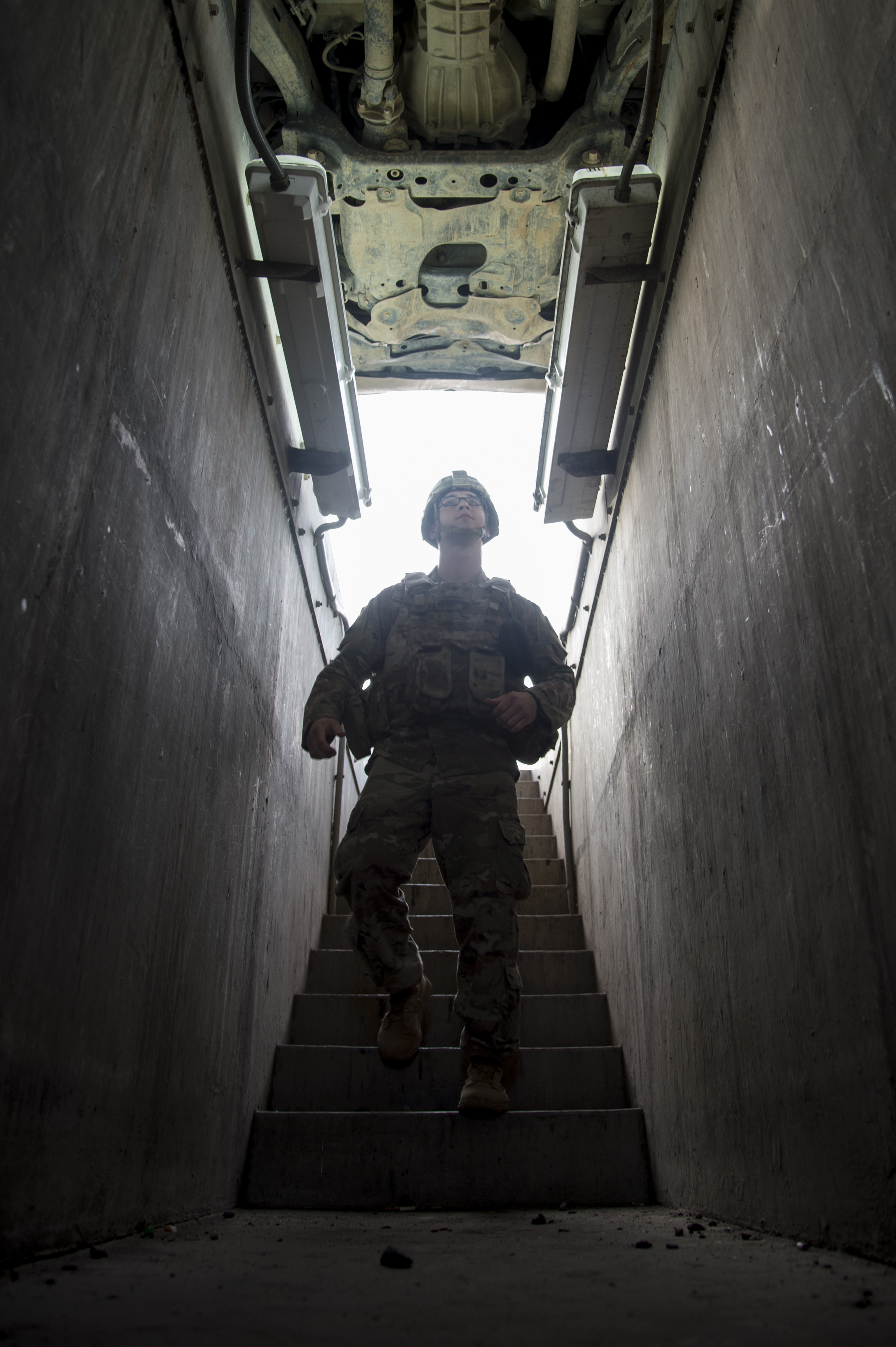 Spc. Austin Katzer,1st Battalion, 153rd Infantry Regiment, deployed with the Combined Joint Task Force-Horn of Africa (CJTF-HOA) in Camp Lemonnier, Djibouti, inspects the undercarriage of a vehicle as part of a random anti-terrorism measure, June 2, 2017. Soldiers of Alpha company secure the installation 24 hours a day and work with Djiboutian contractors to support efforts in countering regional violent extremist organizations. (U.S. Air National Guard photo by Tech. Sgt. Joe Harwood)