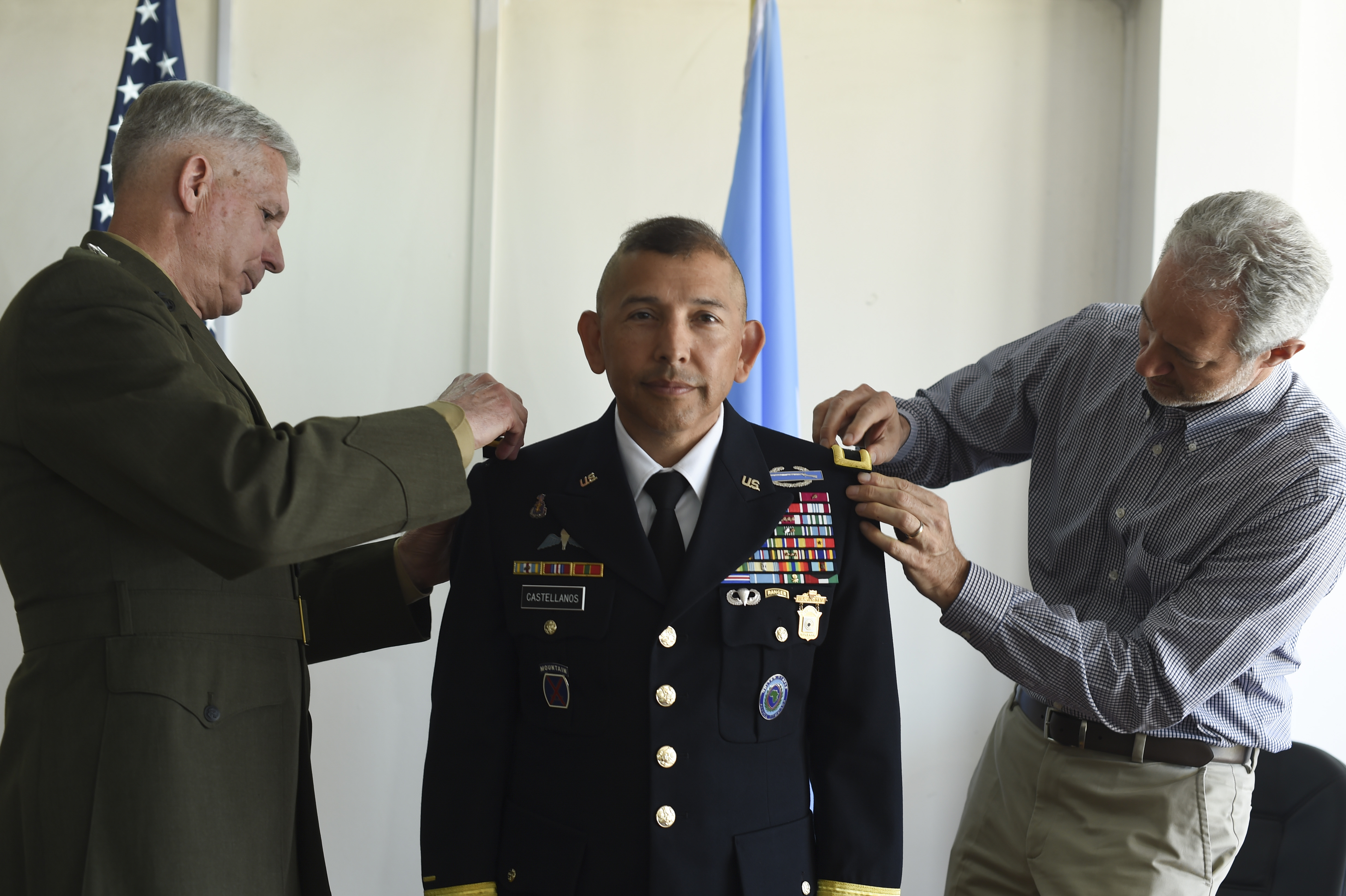 U.S. Army Brig. Gen. Miguel Castellanos, Combined Joint Task Force-Horn of Africa deputy commanding general in Somalia and Mogadishu Coordination Cell director, has his new rank insignia pinned on his uniform by Marine Gen. Thomas Waldhauser, Africa Command commander and Ambassador Stephen Schwartz, U.S. Ambassador to Somalia during a promotion ceremony at MCC, June 4, 2017. Castellanos is the U.S. military liaison to the Federal Government of Somalia, Somali National Security Forces, and the international partners. (U.S. Air Force photo by Staff Sgt. Eboni Prince)