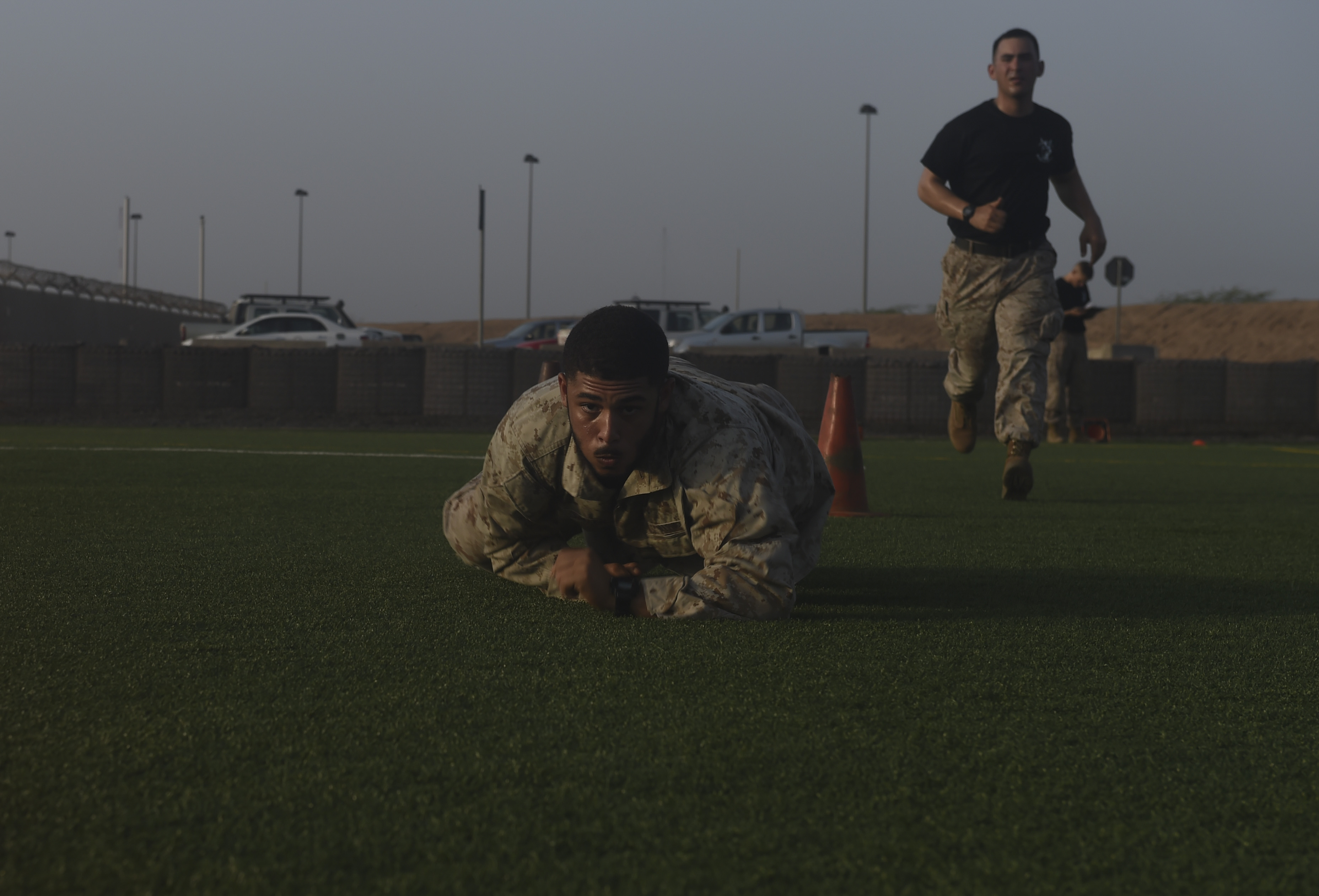 U.S. Marine Corps Cpl. Cameron Smith, assigned to Combined Joint Task Force-Horn of Africa, low-crawls while completing a combat fitness test during the Corporal's Course at Camp Lemonnier, Djibouti, May 31, 2017. During the Corporal's Course, the students received more than 120 hours of instruction over the course of 16 days with a curriculum that consisted of various subjects to include; customs and traditions, land navigation, communications, social media interaction, leadership, and combat fitness. (U.S. Air Force photo by Staff Sgt. Eboni Prince)