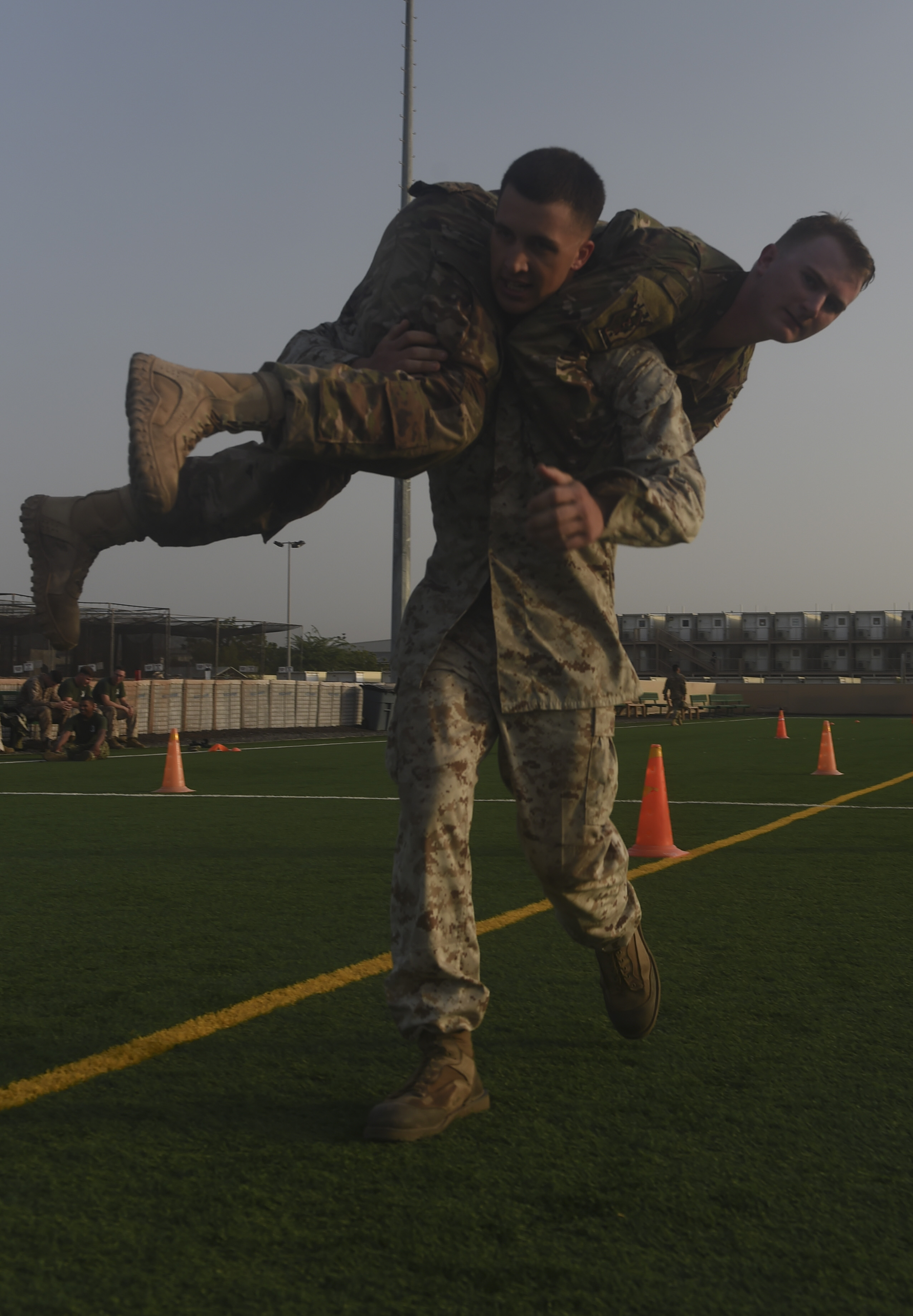 U.S. Marine Corps Cpl. Isaiah Caplan, carries U.S. Air Force Senior Airman Christian Davis, both assigned to Combined Joint Task Force-Horn of Africa, while completing a combat fitness test during the Corporal's Course at Camp Lemonnier, Djibouti, May 31, 2017. A partnered effort between the Marine Corps Element and CJTF-HOA, the Corporals' Leadership Development Course is a professional military education program traditionally for Marine Corps Corporals that places emphasis on basic leadership skills. (U.S. Air Force photo by Staff Sgt. Eboni Prince)