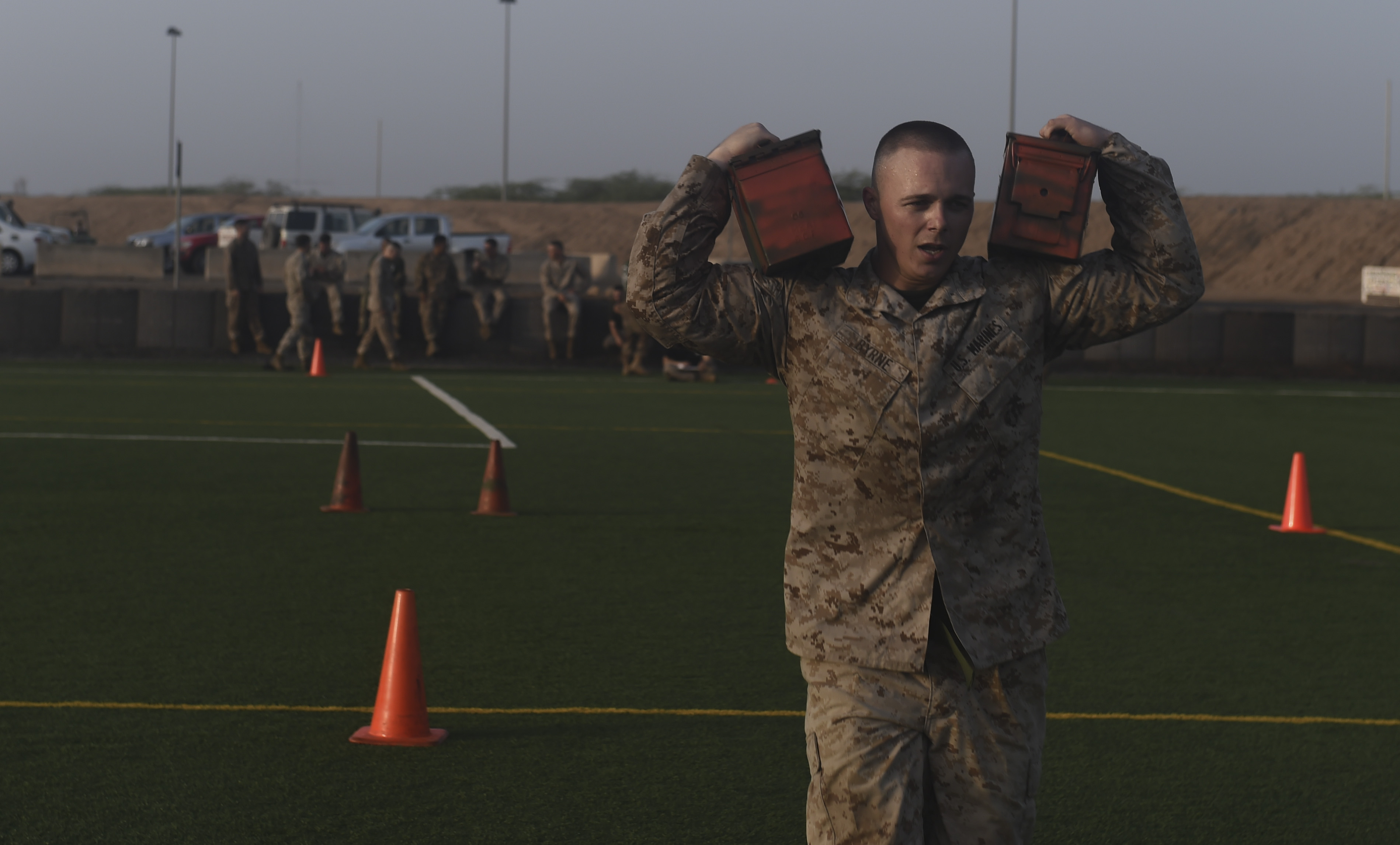 U.S. Marine Corps Cpl Richard Byrne, assigned to Combined Joint Task Force-Horn of Africa, carries ammo cans during a combat fitness test during the Corporal's Course at Camp Lemonnier, Djibouti, May 31, 2017. The course is a requirement for Marines in the enlisted grade of E-4, but here, all U.S. service members in the ranks of corporal, specialist, senior airman or petty officer third class were allowed to participate. (U.S. Air Force photo by Staff Sgt. Eboni Prince)