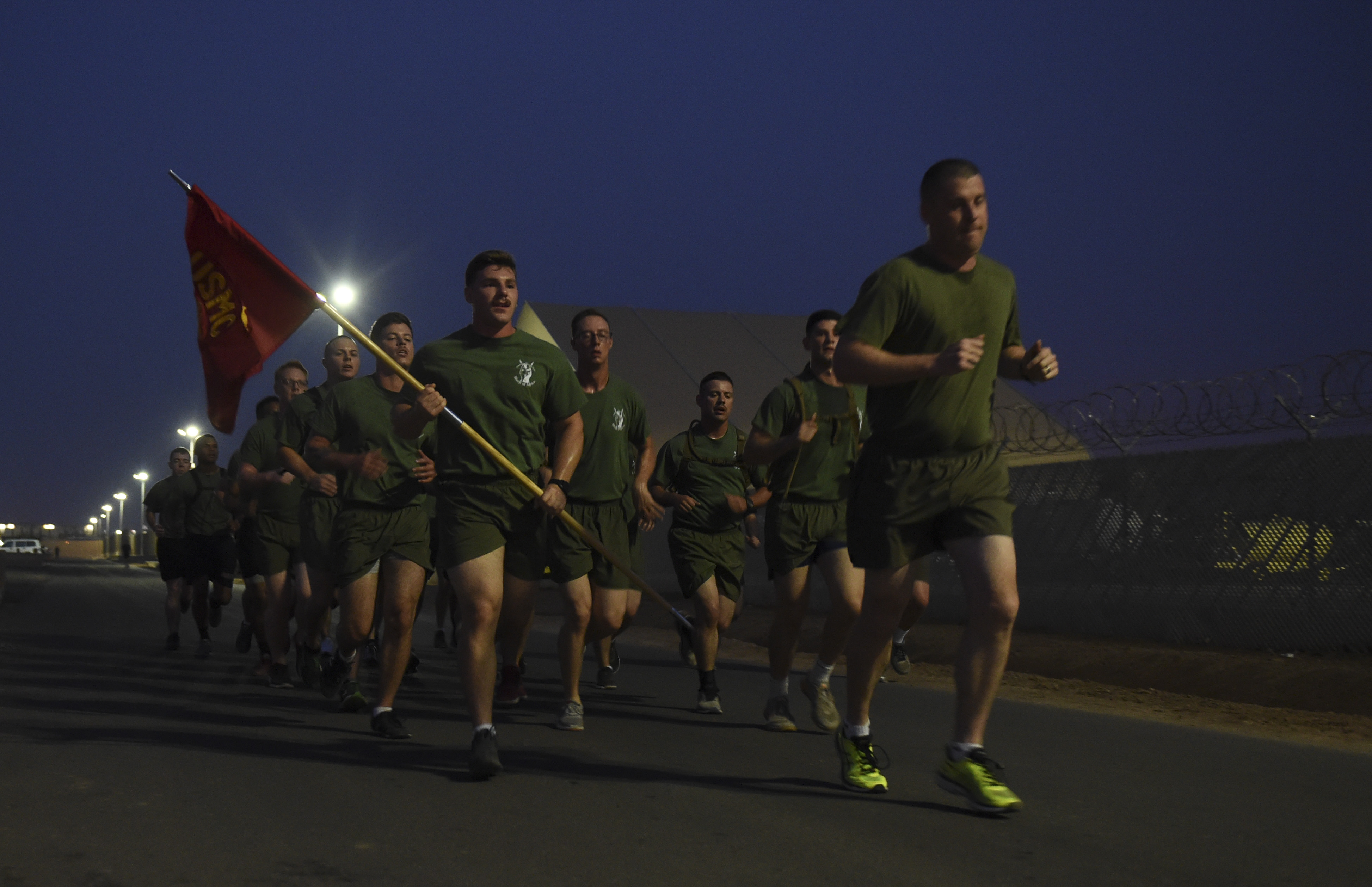 U.S. service members participate in a motivational run around Camp Lemonnier during the Corporal's Course at Camp Lemonnier, Djibouti, June 2, 2017. The course is a requirement for Marines in the enlisted grade of E-4, but here, all U.S. service members in the ranks of corporal, specialist, senior airman or petty officer third class were allowed to participate. (U.S. Air Force photo by Staff Sgt. Eboni Prince)
