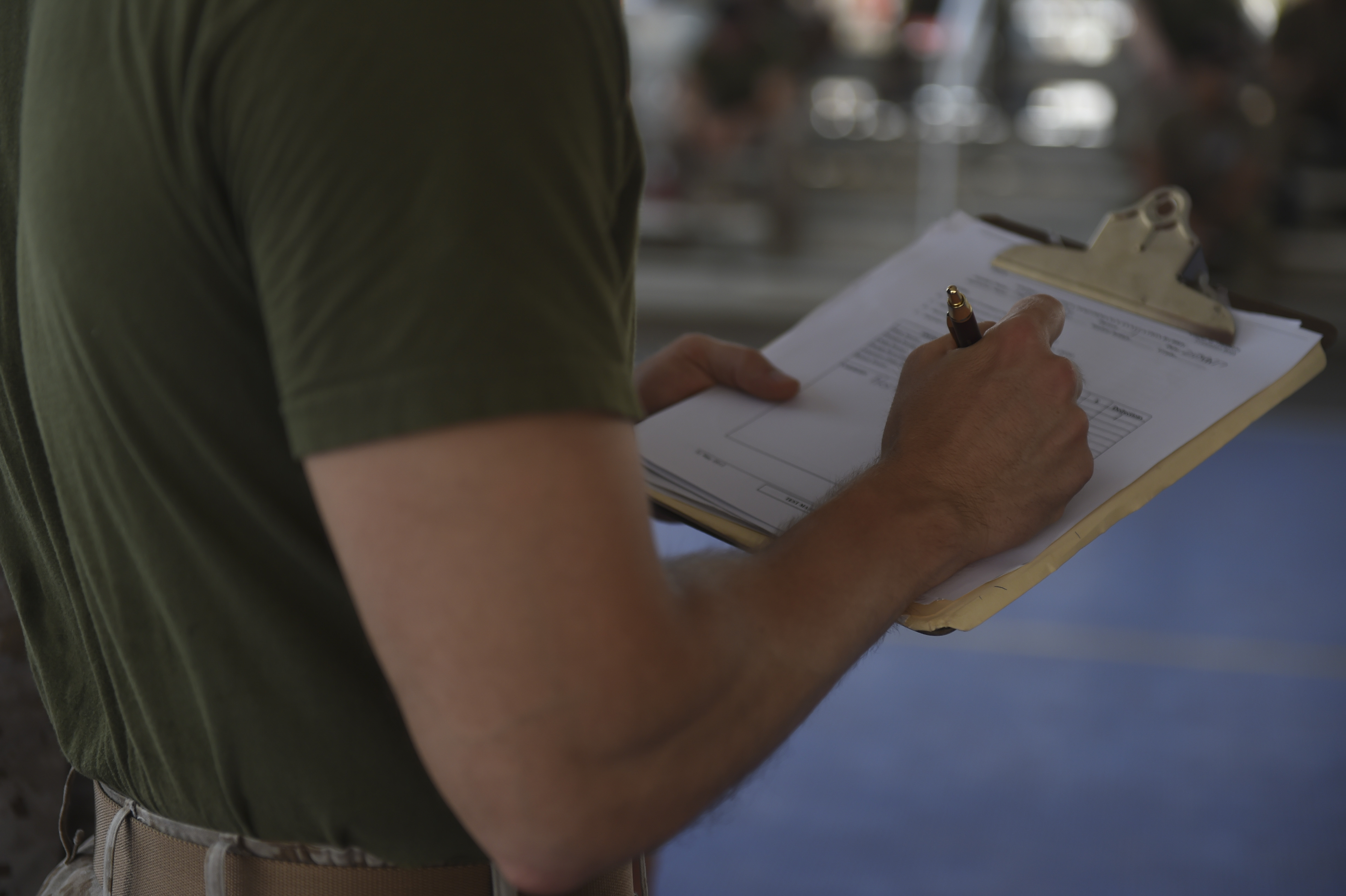 U.S. Marine Corps Sgt. Matthew White, assigned to Combined Joint Task Force-Horn of Africa, marks an evaluation score for a student during the Corporal's Course at Camp Lemonnier, Djibouti, May 24, 2017. A partnered effort between the Marine Corps Element and CJTF-HOA, the Corporals' Leadership Development Course is a professional military education program traditionally for Marine Corps Corporals that places emphasis on basic leadership skills. (U.S. Air Force photo by Staff Sgt. Eboni Prince)