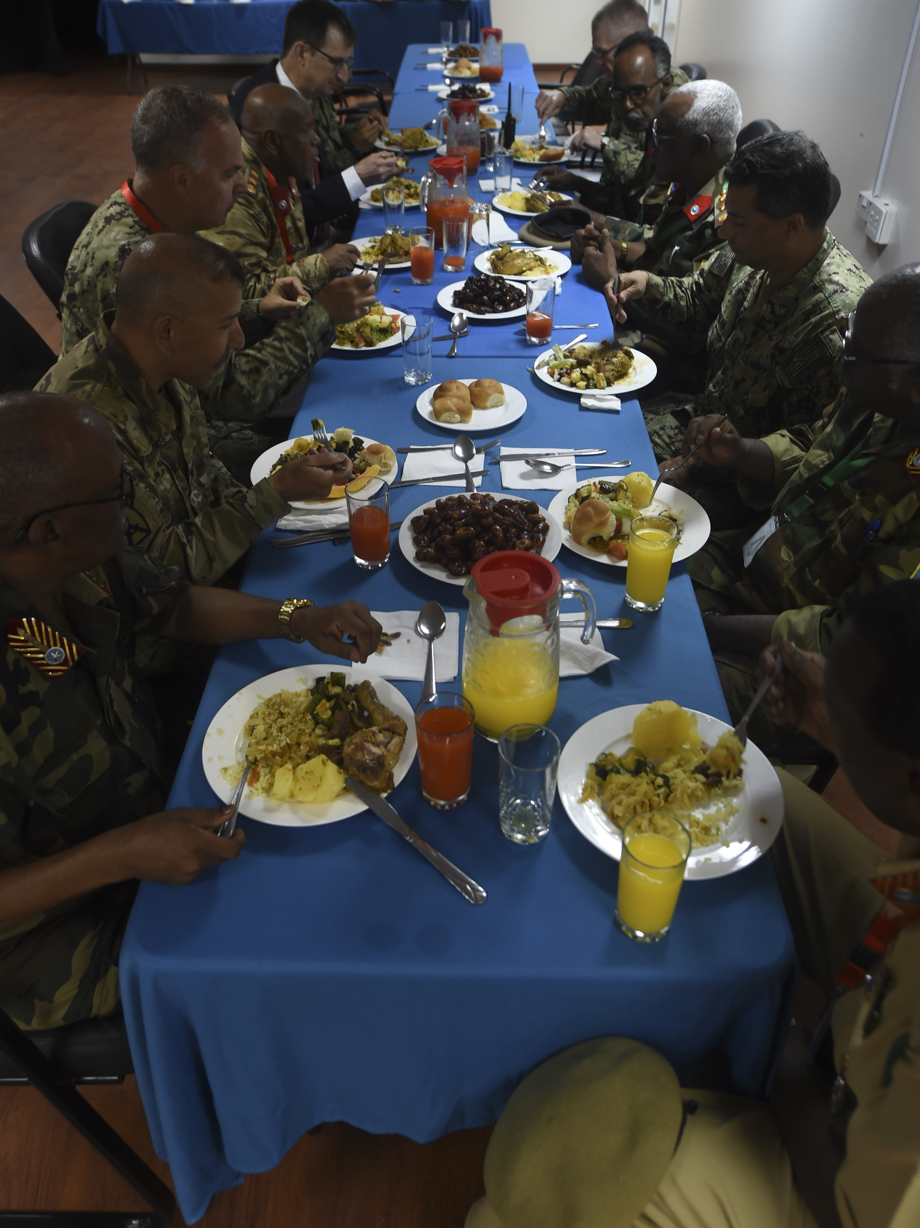Service members from the U.S. and Somali National Army join for an Iftar, the nightly meal that ends the day's fast during Ramadan, at the Mogadishu International Airport in Mogadishu, Somalia, June 5, 2017. U.S. Army Brig. Gen. Miguel Castellanos, Combined Joint Task Force-Horn of Africa deputy commanding general in Somalia and Mogadishu Coordination Cell director, hosted the Iftar, strengthening bonds between the U.S. and Somali militaries. (U.S. Air Force Photo by Staff Sgt. Eboni Prince)