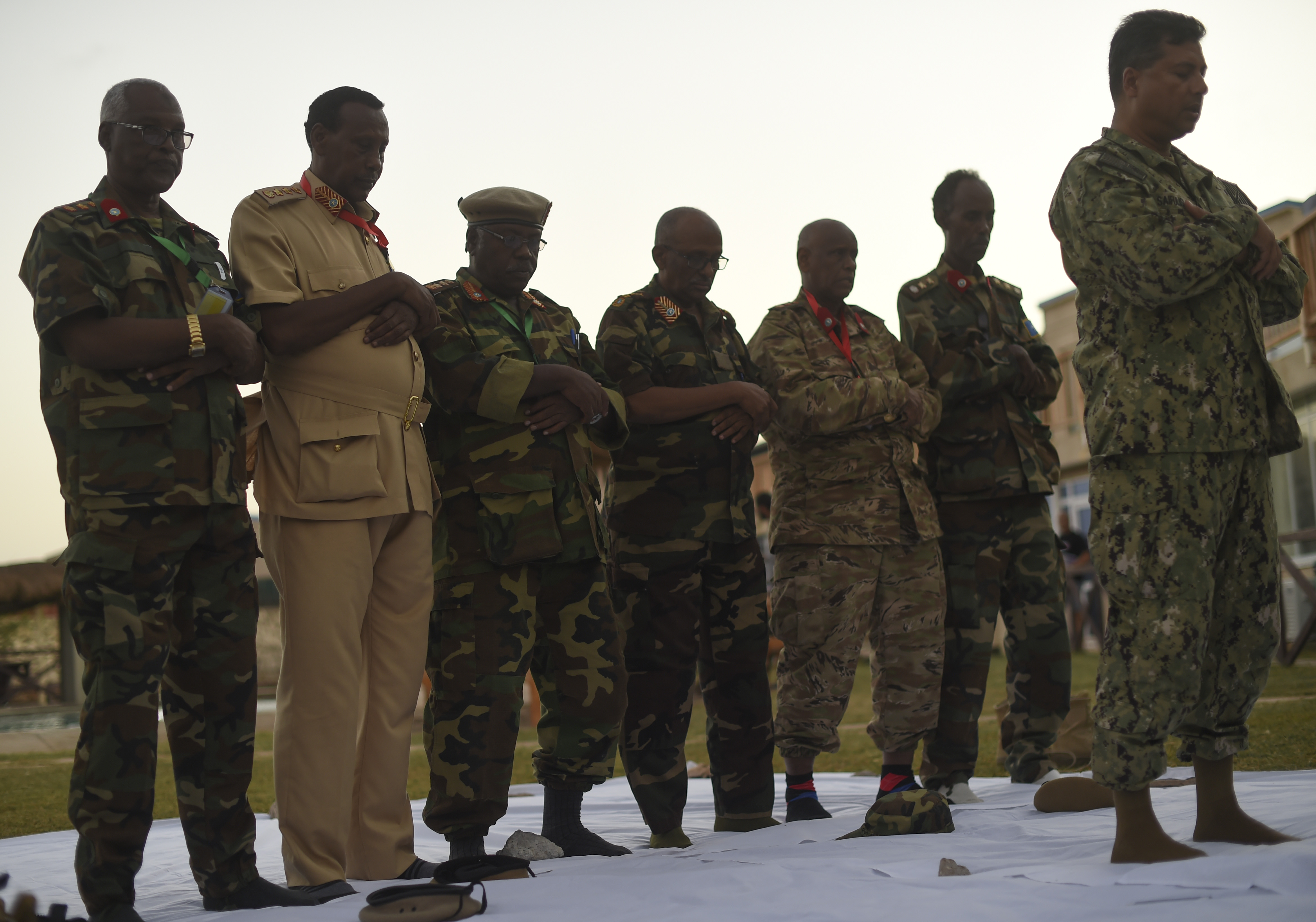 U.S. Navy Cmdr. Abuhena Saifulislam, U.S. Africa Command deputy command chaplain, leads the prayer at the Mogadishu International Airport, Mogadishu, Somalia, June 5, 2017. This was the first Iftar held between U.S. and Somali National Army military personnel. Additionally, it was the first led by a U.S. Imam, who is a leader in the Islamic faith. (U.S. Air Force Photo by Staff Sgt. Eboni Prince)