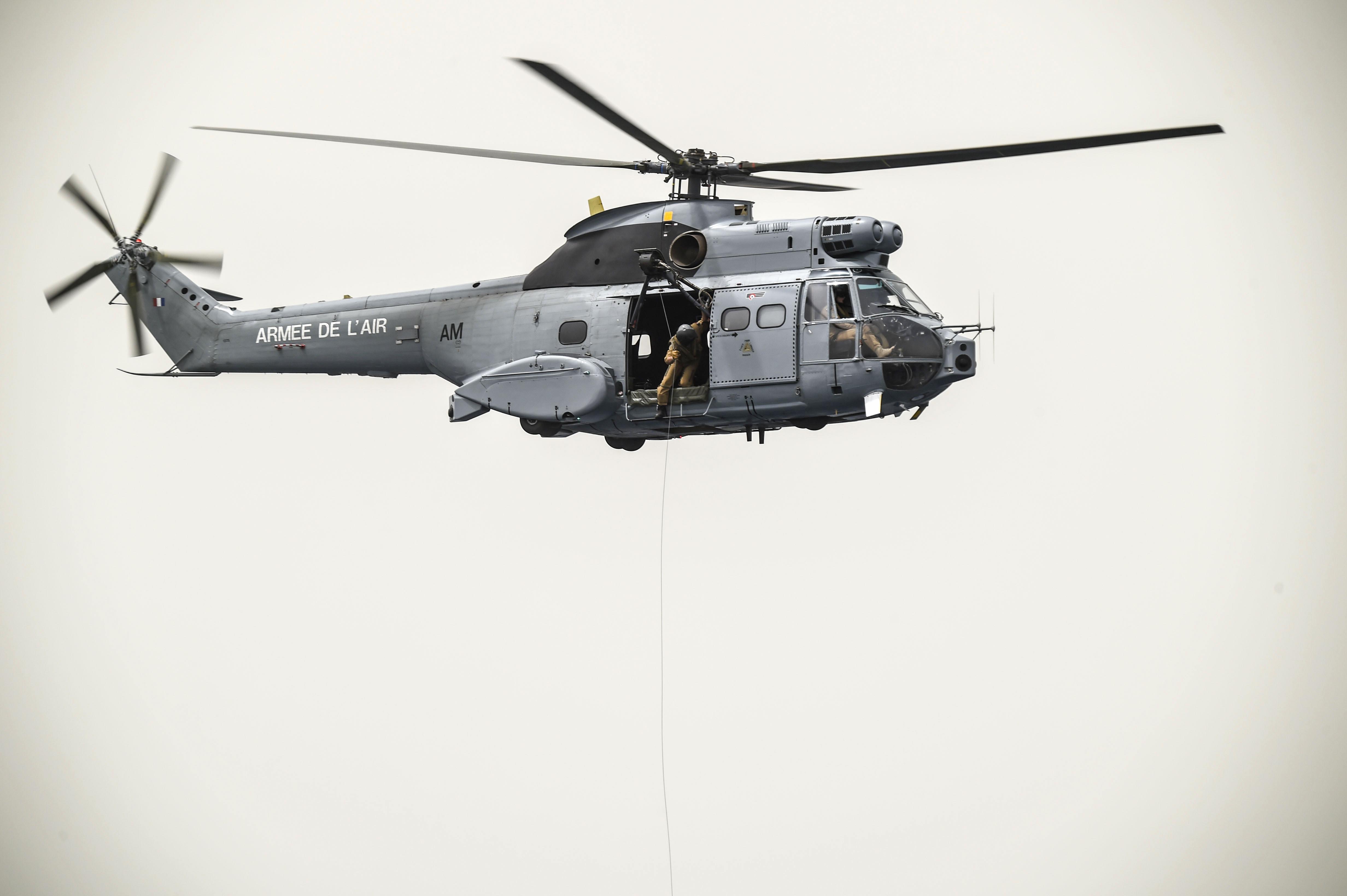 A French Air Force Aérospatiale SA 330 Puma helicopter hovers over the Gulf of Tadjoura during a bilateral water operations exercise pararescuemen  from the 82nd Expeditionary Rescue Squadron, assigned to Combined Joint Task Force-Horn of Africa, in the Gulf of Tadjoura, July 3, 2017. The results of the exercise will aid in the development of standard operating procedures between CJTF-HOA and the French Forces stationed in Djibouti for the U.S. and France's mutual support of maritime  rescue capabilities within the Horn of Africa region.  (U.S. Air Force photo by Staff Sgt. Eboni Prince)