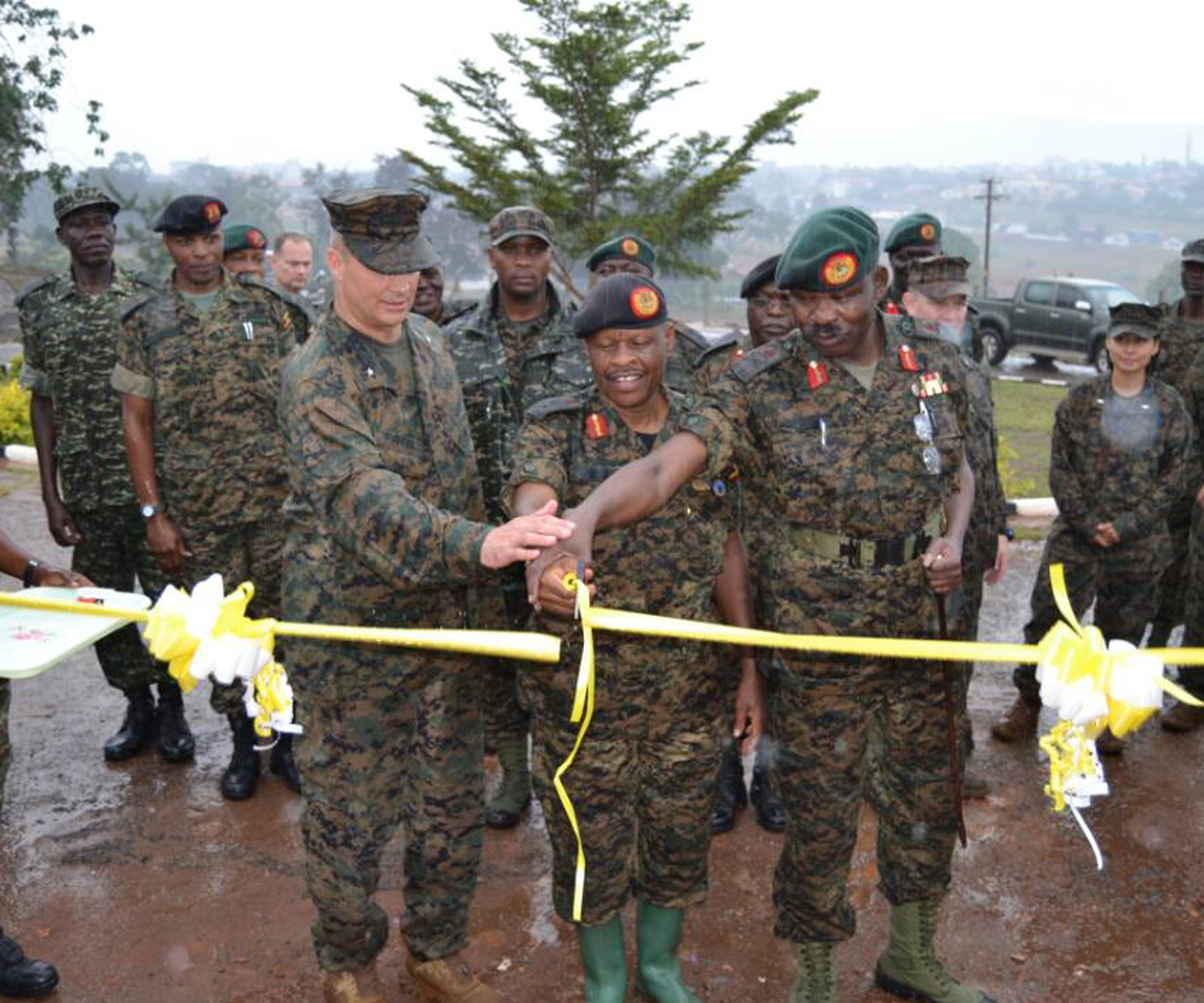 Combined Joint Task Force-Horn of Africa commander U.S. Marine Brig. Gen. David Furness (left) stands side-by-side with Uganda People's Defense Force leadership July 7, 2017, to cut a ribbon marking the grand opening of a training complex at the Uganda Rapid Deployment Capability Center, based in Jinja, Uganda. This took place preceding an historic graduation of 60 UPDF engineers from Class 17.2, which was the first class where UPDF instructors both ran and taught the entire course. Class 17.2's training took place at the Uganda Rapid Deployment Capability Center. (Courtesy photo by Uganda Army Lt. Col. Nelson Aheebwa)