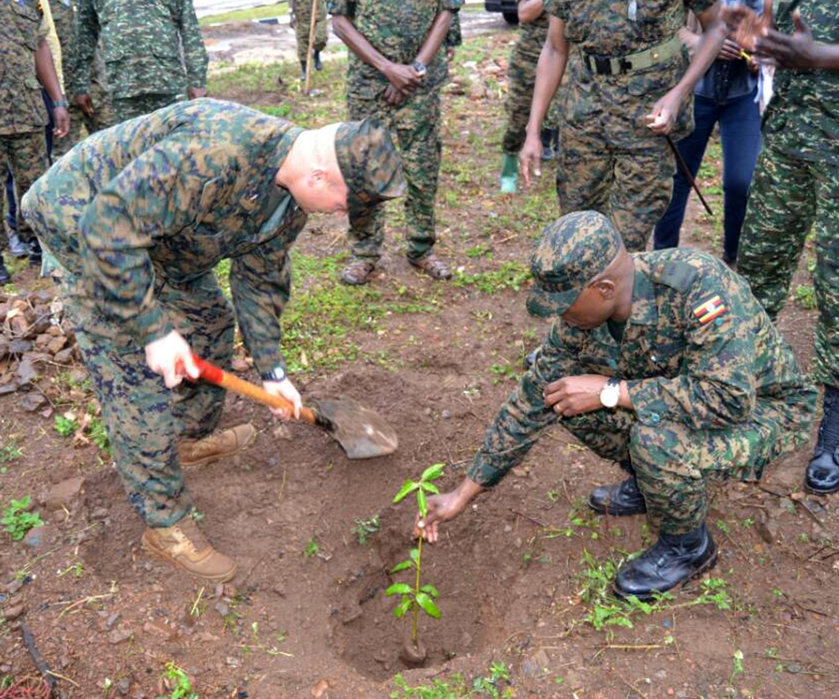Combined Joint Task Force-Horn of Africa commander U.S. Marine Corps Brig. Gen. David Furness (left) helps to plant a mango tree during a tour of the Uganda Rapid Deployment Capability Center, based in Jinja, Uganda, July 7, 2017. This took place on the same day same day as an historic graduation of 60 UPDF engineers from Class 17.2, which was the first class where UPDF instructors both ran and taught the entire course. Class 17.2's training took place at the Uganda Rapid Deployment Capability Center. (Courtesy photo by Uganda Army Lt. Col. Nelson Aheebwa)