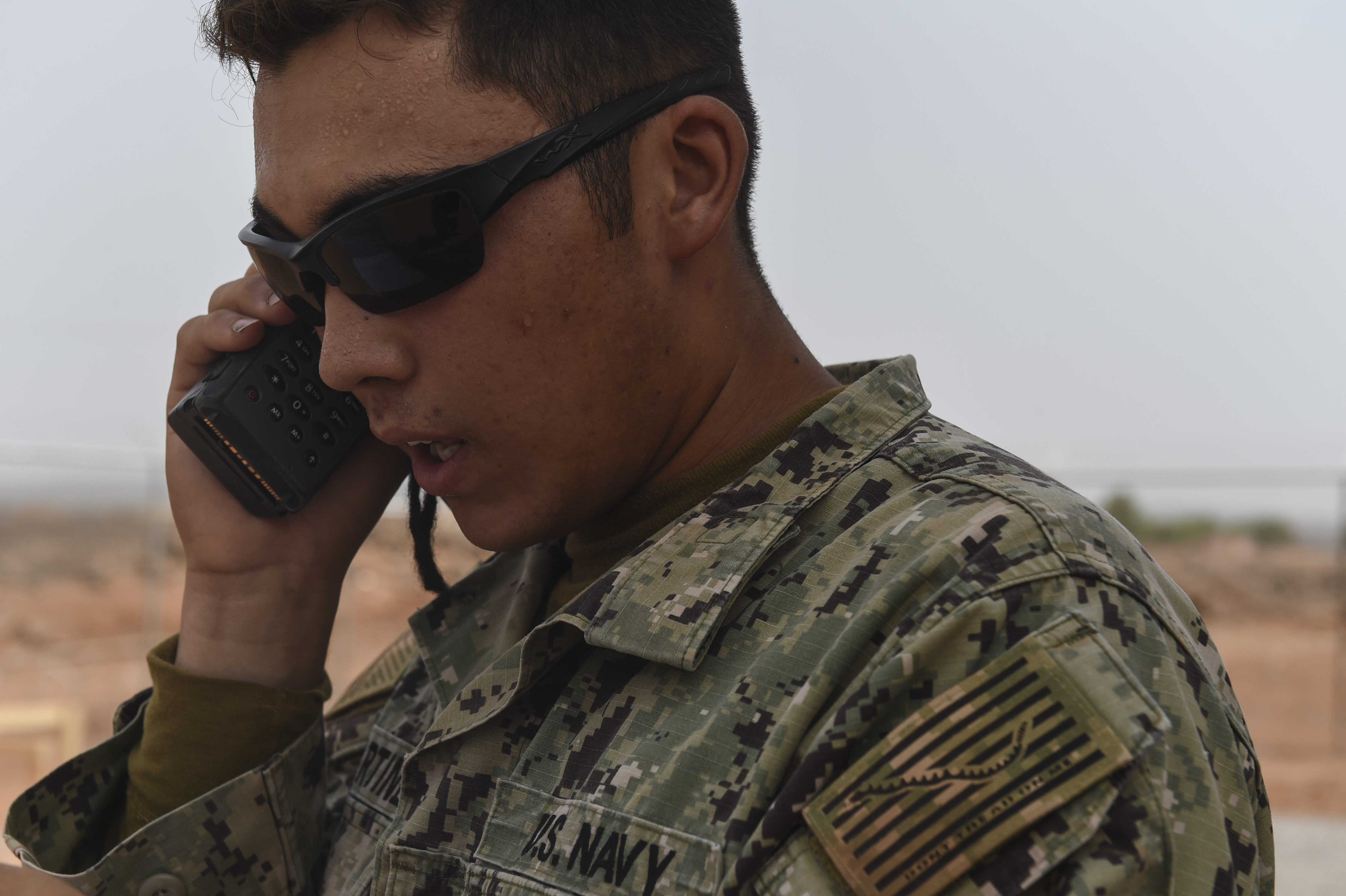 U.S. Navy Petty Officer 3rd Class Jesse Martinez from the Naval Mobile Construction Battalion One, a maneuver unit of the Combined Joint Task Force-Horn of Africa, uses a radio to call the French Air Force Tactical Airlift Squadron 88 for assistance with medical evacuation during a bilateral exercise with French forces in the Arta region, July 19, 2017. CJTF-HOA partners with French counterparts to strengthen regional cooperation and interoperability, enhancing the mutual ability to conduct operations in the region. (U.S. Air Force photo by Staff Sgt. Eboni Prince)
