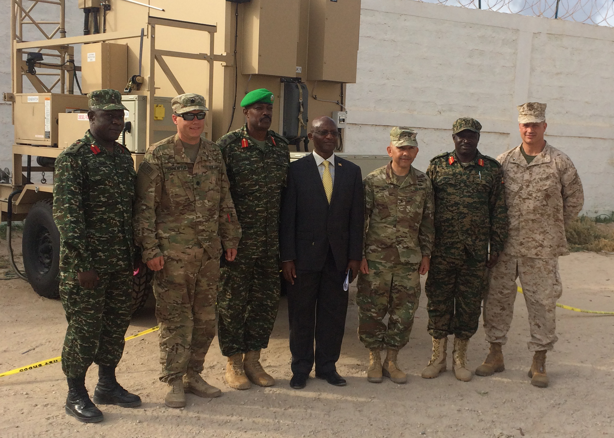 From Left: Col. Tingira Irumba, Ugandan Defense Attache to Somalia  U.S. Army Lt. Col. Rick Sonnenfeld, CJTF-HOA Mogadishu, Somalia  Brig. Gen. Kayanja Muhanga Sector 1 Commander UPDF  Mugisha Nathan, Ugandan Deputy Ambassador to Somalia   U.S. Army Brig. Gen. Miguel Castellanos, DCG CJTF-HOA Mogadishu, Somalia  Maj. Gen. Peter Elwelu, Ugandan Peoples Defense Force, Chief of Land Forces  U.S. Marine Brig. Gen. David Furness, Commanding General CJTF-HOA