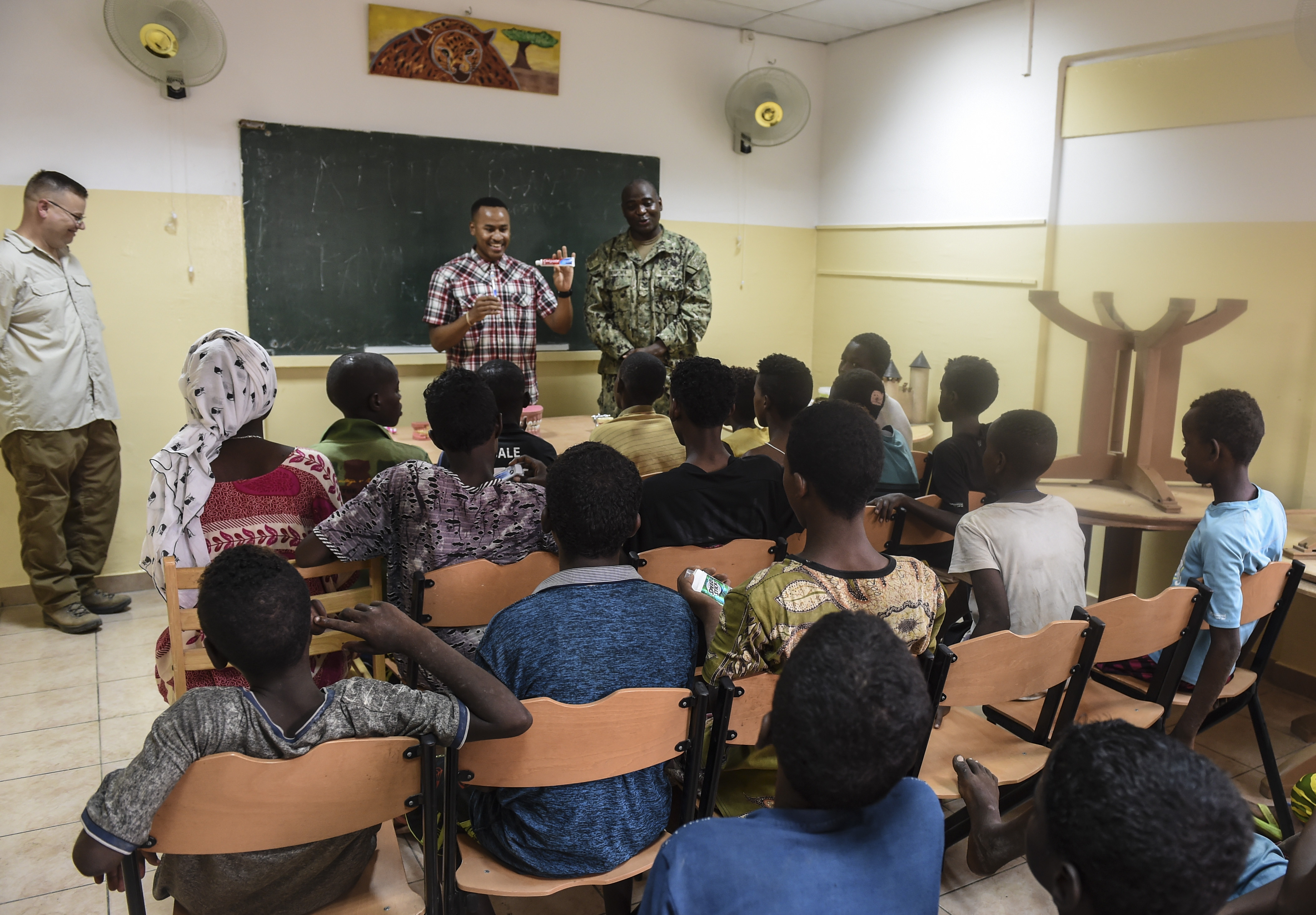 U.S. Army Sgt. Justin Wallace, a dental specialist with the 443rd Civil Affairs Battalion functional specialty team, shows children a tube of toothpaste during a dental demonstration in Djibouti City, Djibouti, Aug. 8, 2017. With demonstrations such as these, the team contributes to the Combined Joint Task Force-Horn of Africa's efforts to promote regional security, stability and prosperity. (U.S. Air Force photo by Staff Sgt. Eboni Prince)