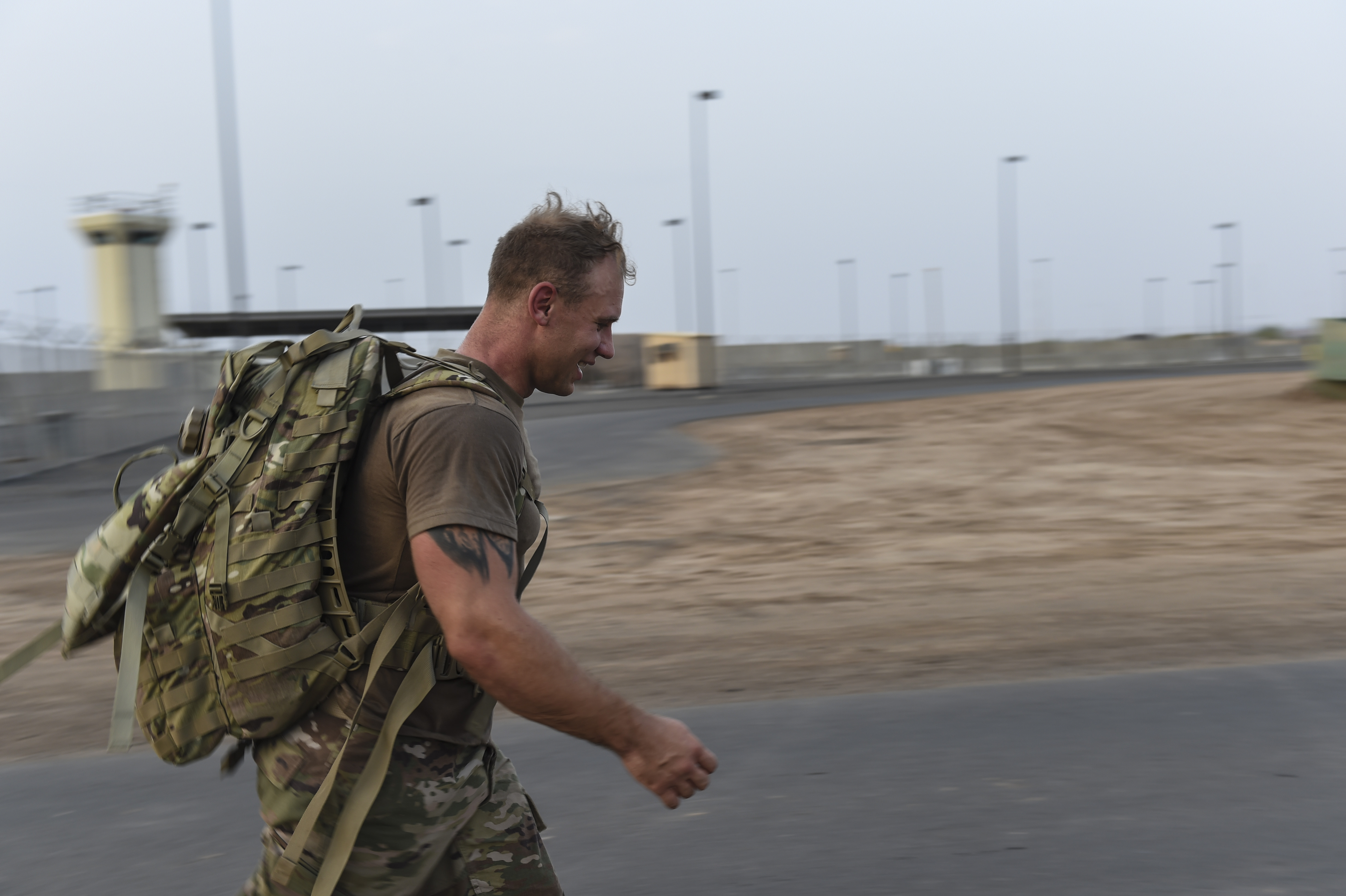 A U.S. service member participates in a ruck march during a physical training test at Camp Lemonnier, Djibouti, Aug. 5, 2017. The test was in preparation for an upcoming multi-day French Desert Commando Course that will challenge participants physically and mentally through land and water obstacles, combat scenarios and extreme endurance exercises while surviving in austere field conditions. (U.S. Air Force photo by Staff Sgt. Eboni Prince)