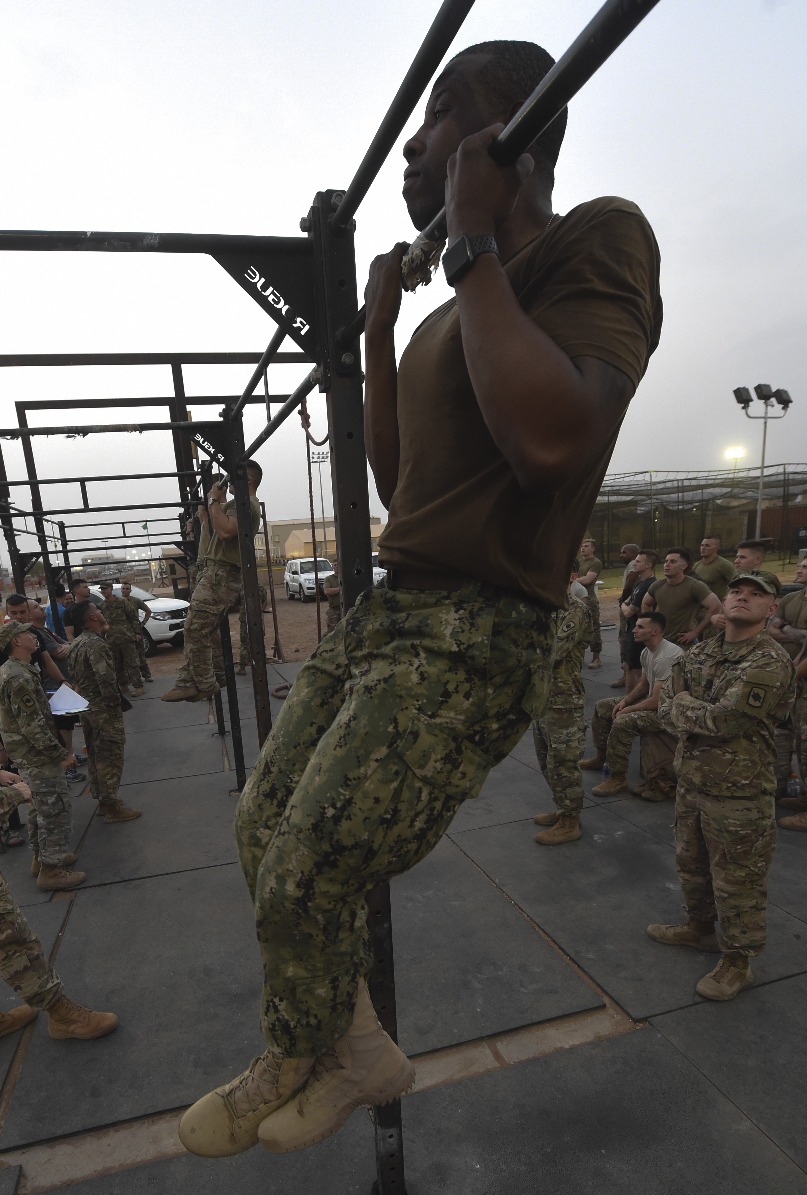 A U.S. service member completes a flexed arm hang during a physical training test at Camp Lemonnier, Djibouti, Aug. 5, 2017. The test was in preparation for an upcoming multi-day French Desert Commando Course that will challenge participants physically and mentally through land and water obstacles, combat scenarios and extreme endurance exercises while surviving in austere field conditions. (U.S. Air Force photo by Staff Sgt. Eboni Prince)