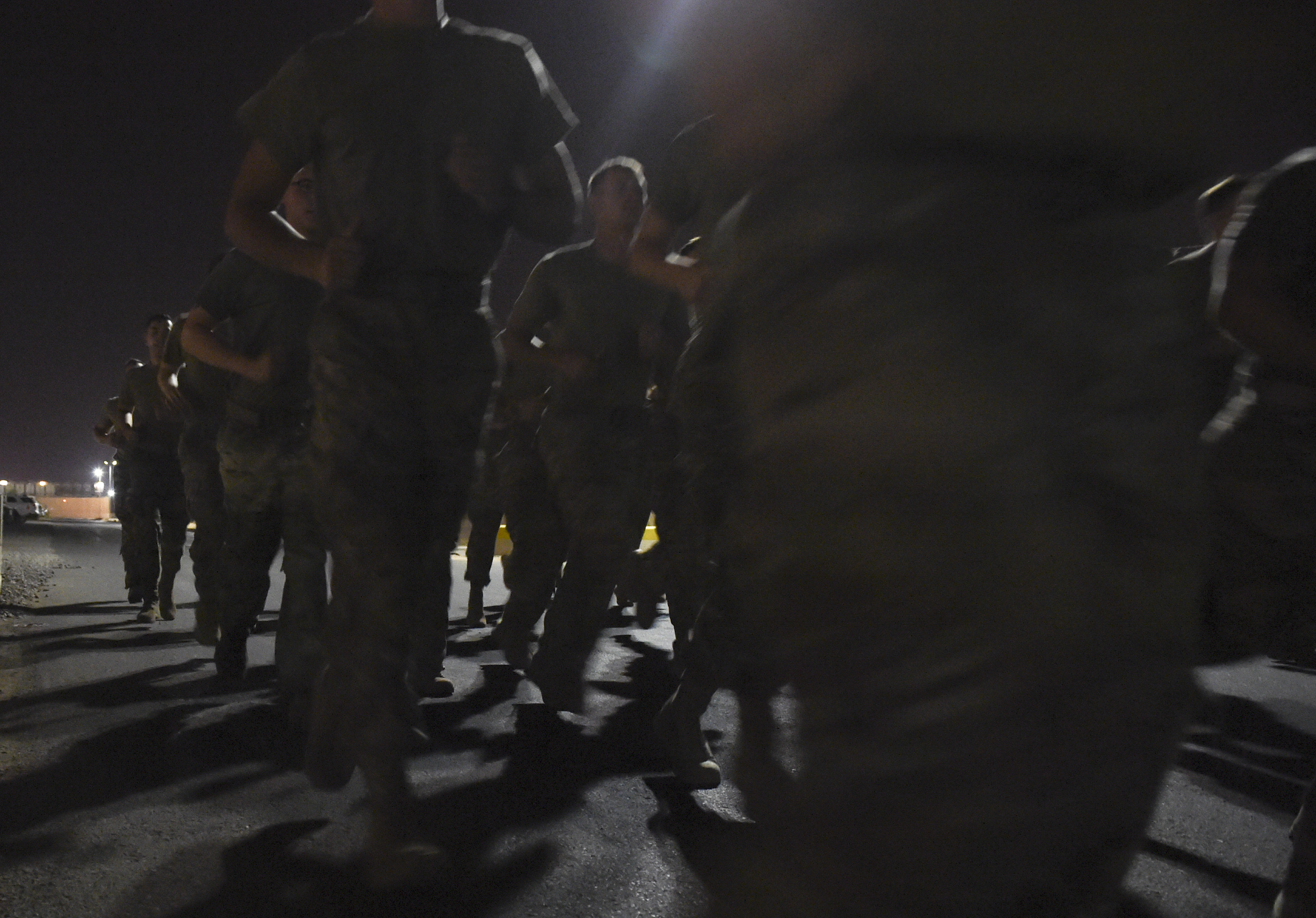 U.S. military members participated in a 5-mile run during a physical training test at Camp Lemonnier, Djibouti, Aug. 5, 2017. The test was in preparation for an upcoming multi-day French Desert Commando Course that will challenge participants physically and mentally through land and water obstacles, combat scenarios and extreme endurance exercises while surviving in austere field conditions. (U.S. Air Force photo by Staff Sgt. Eboni Prince)
