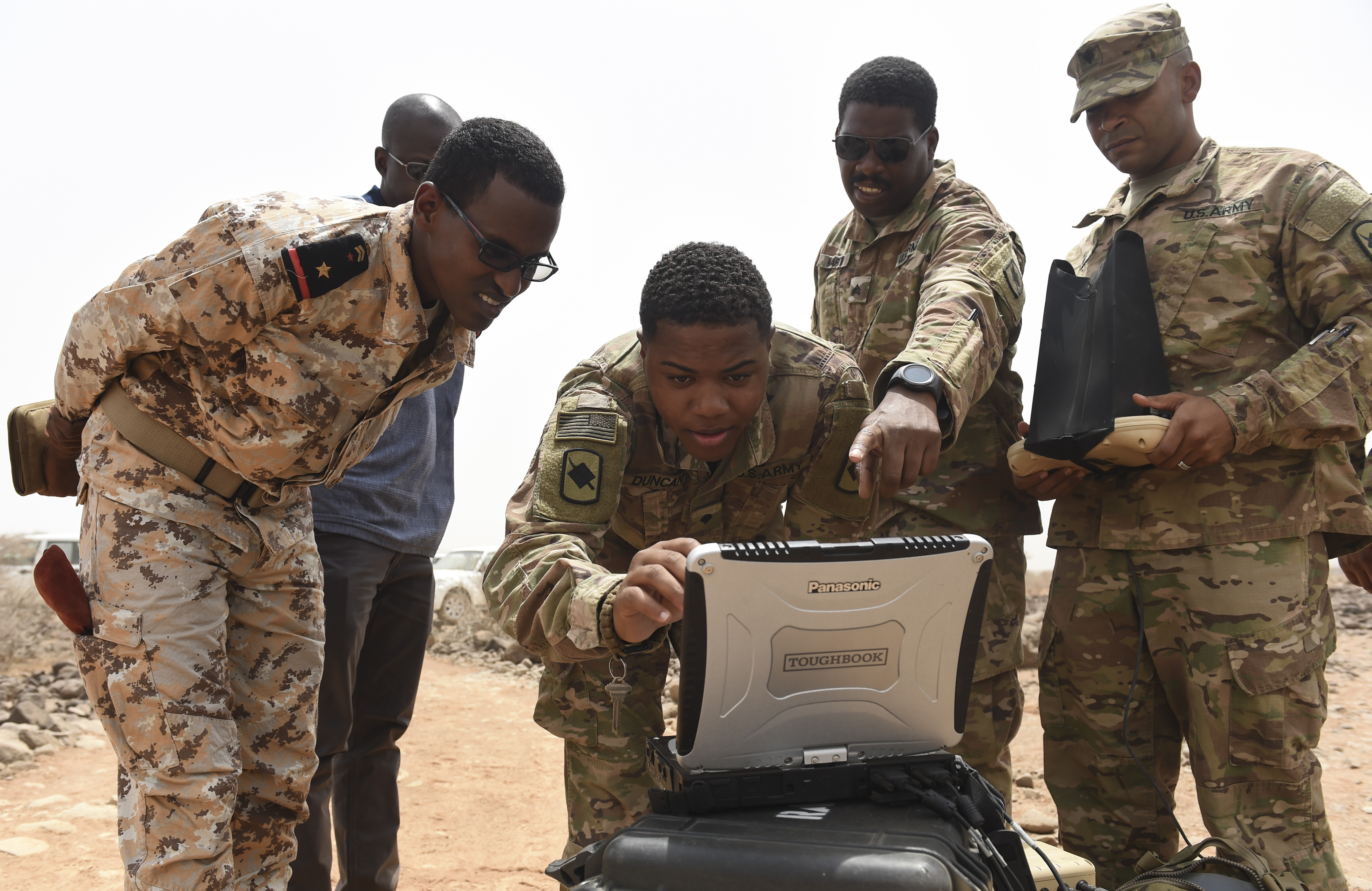 U.S. Army Soldiers assigned to the 1st Battalion, 153rd Infantry Regiment, Task Force Warrior, an associated unit of Combined Joint Task Force - Horn of Africa, demonstrate the use of a ground control station in an airfield in southern Djibouti, Aug. 21, 2017. The demonstration was given in an effort to help the Djibouti Armed Forces determine if the RQ-11 Raven remotely piloted aircraft might benefit FAD operations that maintain stability and security in and around Djibouti. (U.S. Air Force photo by Staff Sgt. Eboni Prince)