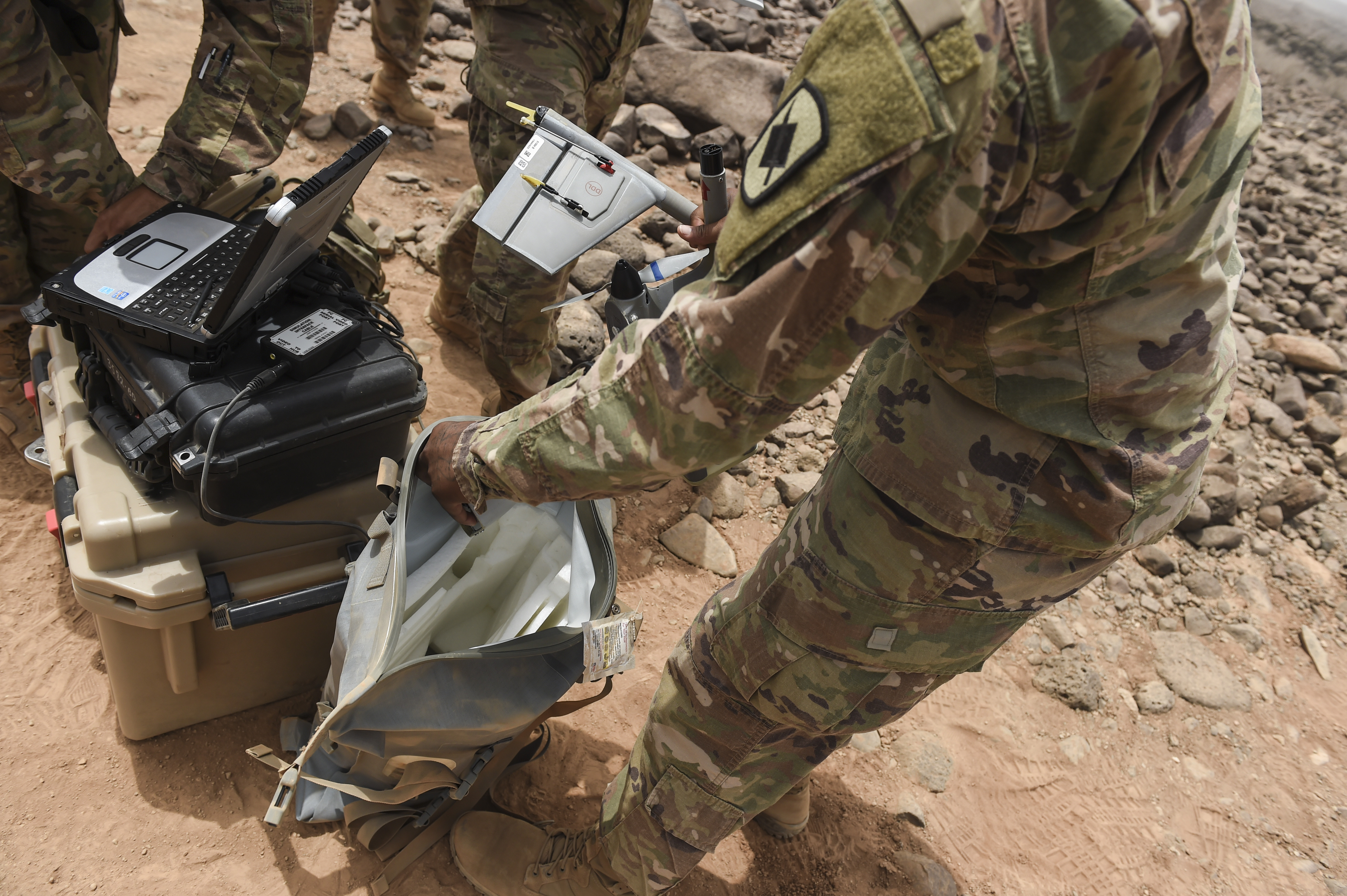 A U.S. Army Soldier assigned to the 1st Battalion, 153rd Infantry Regiment, Task Force Warrior, an associated unit of Combined Joint Task Force - Horn of Africa, disassembles a Raven RQ-11 system during a demonstration in an airfield in southern Djibouti, Aug. 21, 2017. This was part of an effort to familiarize Djibouti Armed Forces members with the unmanned aerial vehicle system, clear up confusion about the Raven RQ-11 and other RPAs, and show the safe operation of the Raven. (U.S. Air Force photo by Staff Sgt. Eboni Prince)