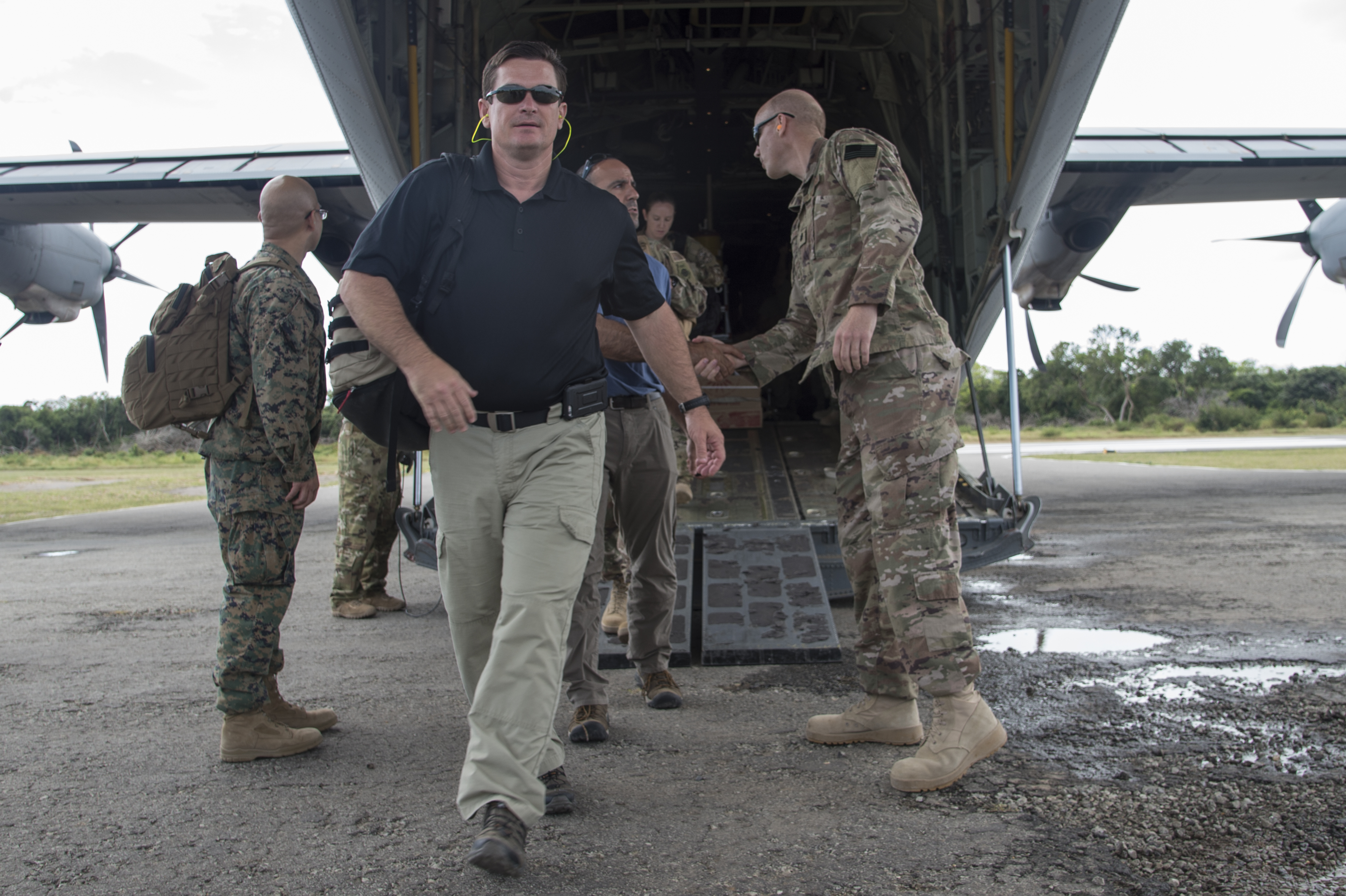 Rep. Austin Scott (R-Ga.) and Rep. Jimmy Panetta (D-Calif.) are greeted by military members as members at a forward operating location in East Africa as part of a congressional delegation (CODEL) visit on Aug. 27, 2017. The group visited various locations in the Combined Joint Task Force - Horn of Africa area of responsibility, including Somalia, to meet U.S. service members and learn more about the U.S. military mission in East Africa. This is the first time in three years a CODEL has visited Somalia. The CODEL included the following congressmen, all of whom are on the House Armed Service Committee; Rep. Austin Scott representing the 8th District of Georgia, Jimmy Panetta representing the 20th District of California and Marc Veasey (D-Texas) representing the 33rd District of Texas. (U.S. Air National Guard photo by Tech. Sgt. Joe Harwood)