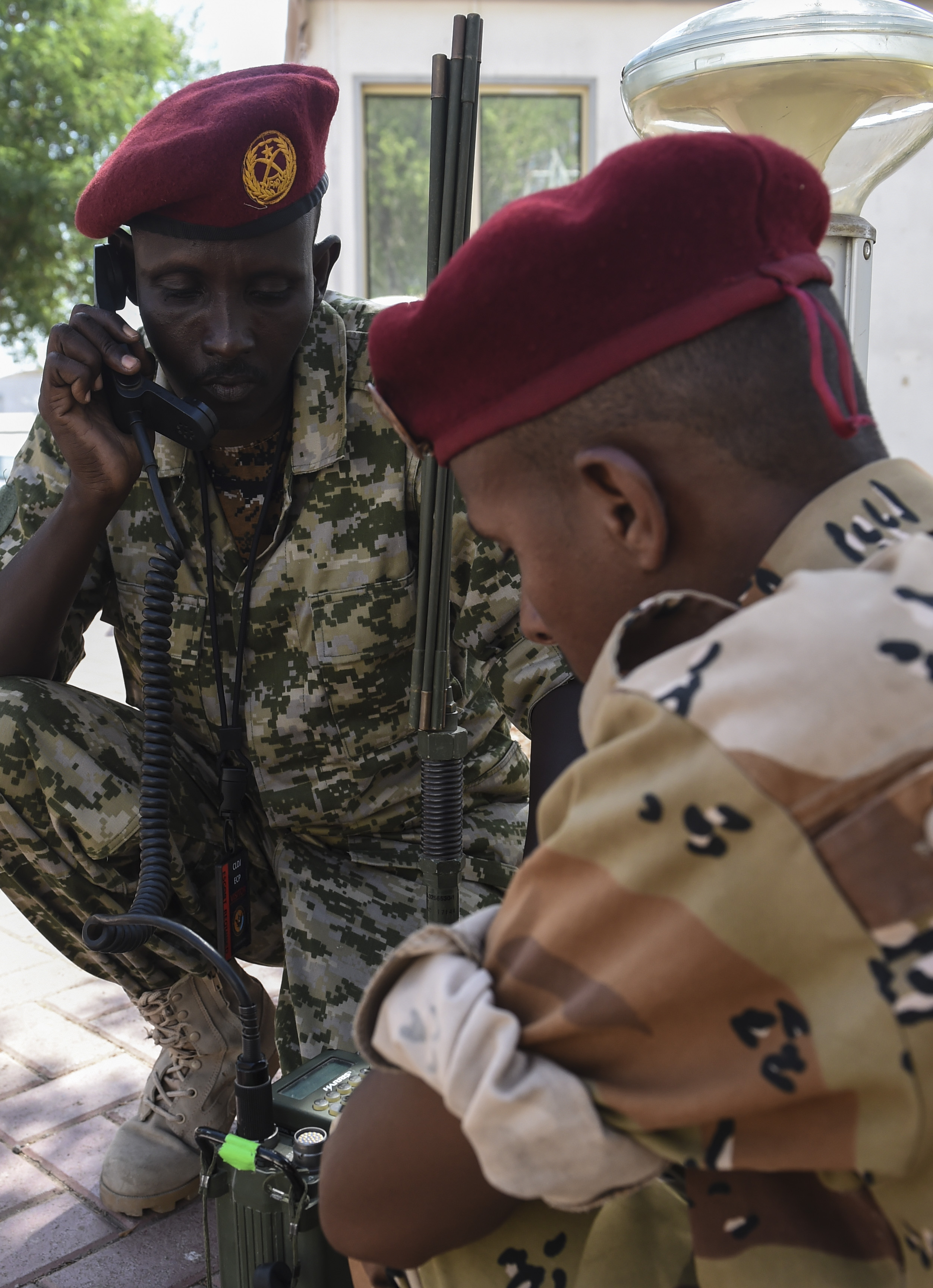 Two Djibouti Armed Forces members use Harris radios during a three-day best practices sharing session with radio operators from the Combined Joint Task Force-Horn of Africa communications directorate at Camp Lemonnier, Oct. 3, 2017. Best-practice sharing events like these help East African partners to strengthen their defense capabilities, capacity, and coordination to enable them to provide for their own security, combat transnational threats, and respond to crises. (U.S. Air Force photo by Staff Sgt. Eboni Prince)