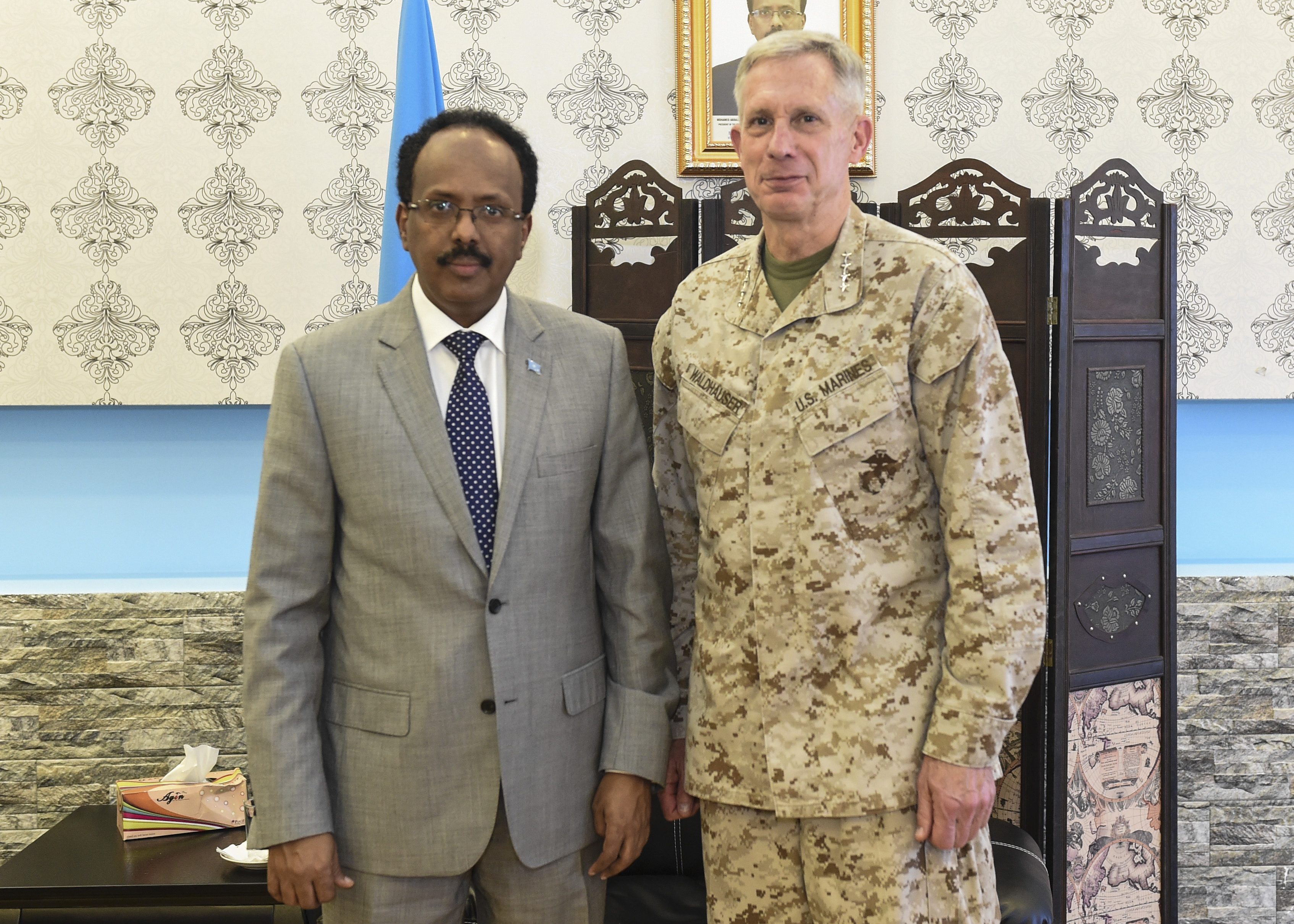 Somalia President Mohamed Abdullahi Mohamed and U.S. Marine Corps Gen. Thomas Waldhauser, U.S. Africa Command commander, pose for a photo in Mogadishu, Somalia, Oct. 12, 2017. Waldhauser and Martin Dale, the Chargé d'Affaires of the U.S. Mission to Somalia, along with other senior U.S. military and Department of State leaders, visited Somalia to engage with key Somalia stakeholders and express the U.S. government's commitment to the security and stability of the Federal Government of Somalia, Somali National Security Forces, and the African Union Mission in Somalia. (U.S. Air Force photo by Staff Sgt. Eboni Prince)