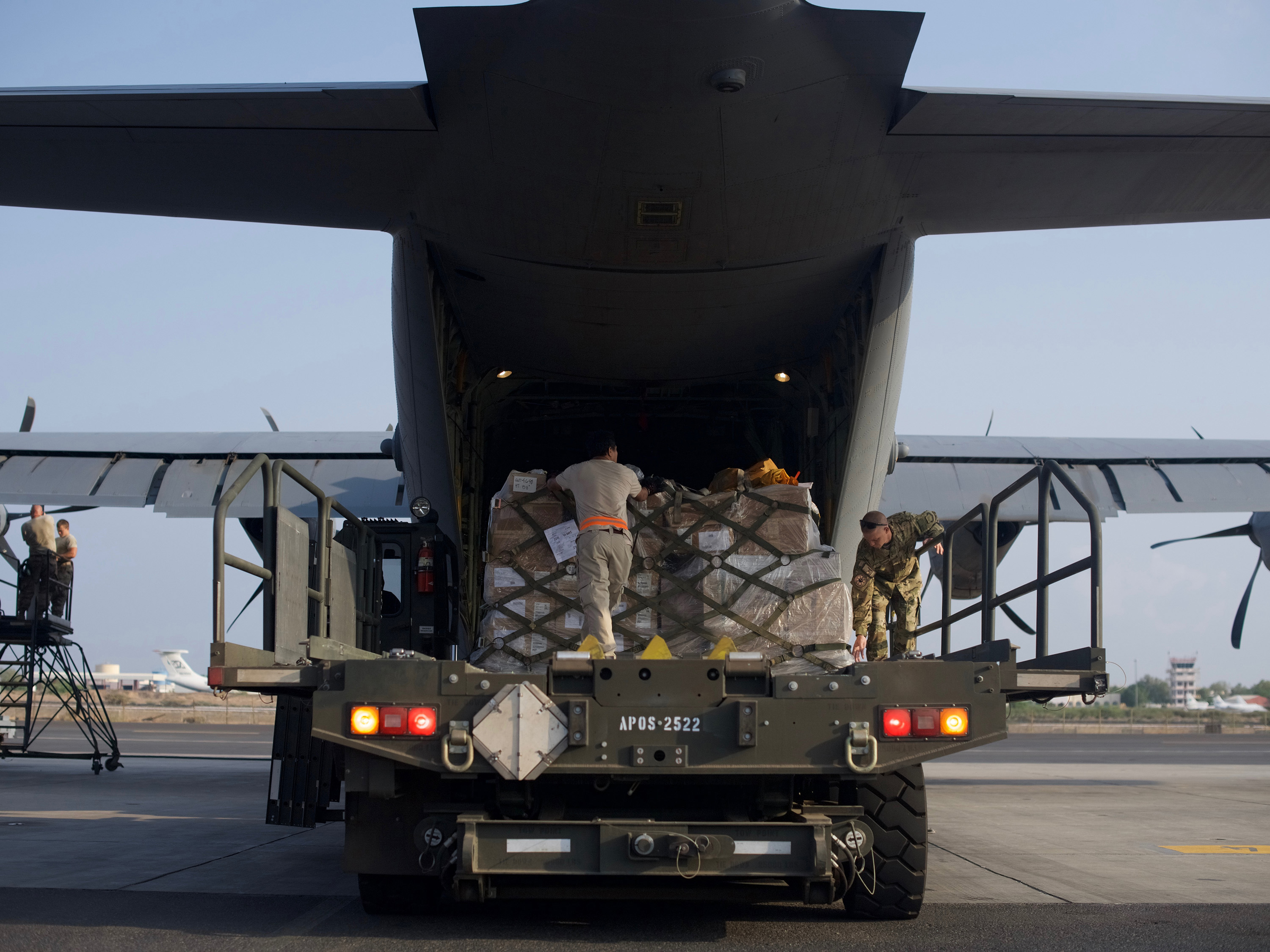 U.S. Airmen from the 449th Air Expeditionary Group load pallets of medical and humanitarian aid supplies onto a U.S. C-130J Super Hercules at Camp Lemonnier, Djibouti, Oct. 17, 2017. The aid is being delivered to the Somali people following a devastating terrorist attack that killed and injured hundreds in Mogadishu on Oct. 14. Working with the Federal Government of Somalia, the U.S. Mission to Somalia immediately arranged for the air shipment. On a Combined Joint Task Force-Horn of Africa mission, the C-130 carried several pallets of medical equipment and supplies. The United States will continue to stand with the Somali government, its people, and international allies to combat terrorism and support efforts to achieve peace, security and prosperity. (U.S. Air Force photo by Staff Sgt. Gustavo Castillo)
