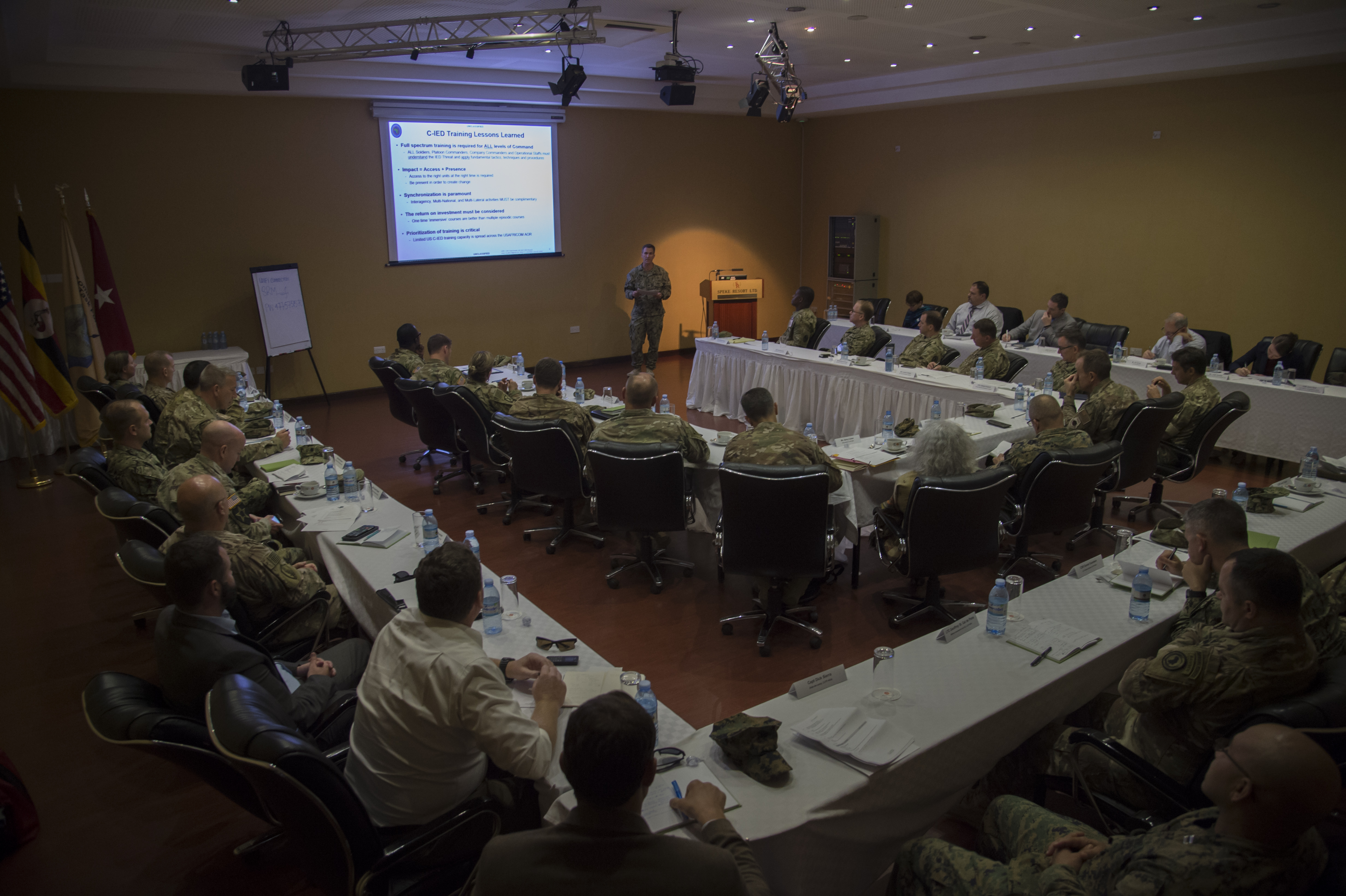 U.S. Navy Cmdr. Chad Houllis, U.S. Africa Command (AFRICOM) countering improvised explosive devices (C-IED) branch, presented a C-IED threat mitigation in Somalia presentation during the 2017 East African Senior Defense Official/Defense Attaché Conference in Kampala, Uganda on Oct. 18, 2017. Subject matter experts from a variety of government agencies discussed military partnership opportunities that enhance security and stability throughout East Africa. (U.S. Air National Guard photo by Tech. Sgt. Joe Harwood)