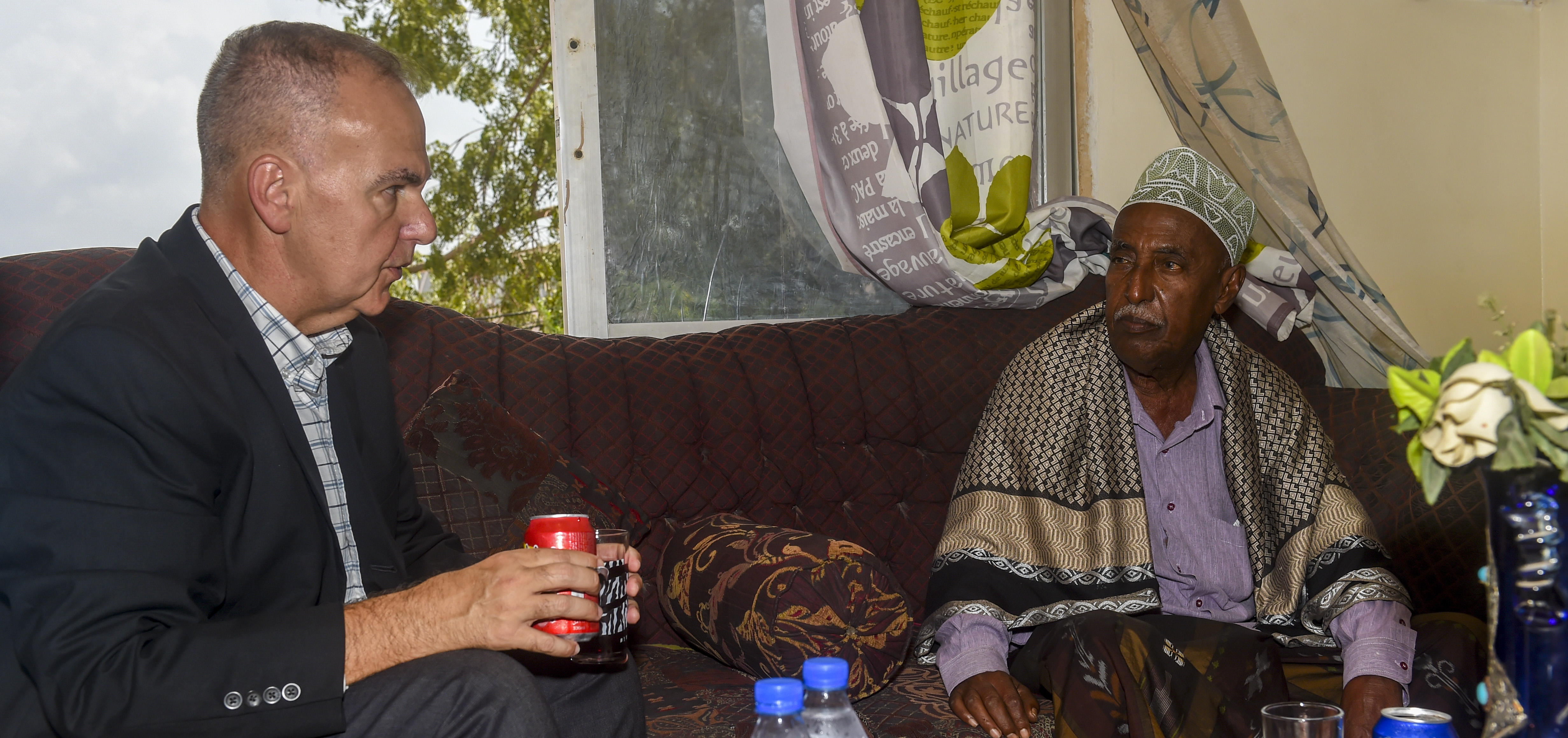 U.S. Navy Capt. David Rodriguez (left), Combined Joint Task Force - Horn of Africa Religious Affairs director, speaks with Abdelkader Mohamed Humad, Sultan of Tadjoura, during a visit to his home in Djibouti City, Djibouti, Nov. 4, 2017. They discussed visits to orphanages and schools to bring food and clothing, help with health issues, and teach English.  The English lessons were particularly interesting to Humad, as they will make the children of Tadjoura more competitive in the future job market. (U.S. Air Force photo by Staff Sgt. Timothy Moore)