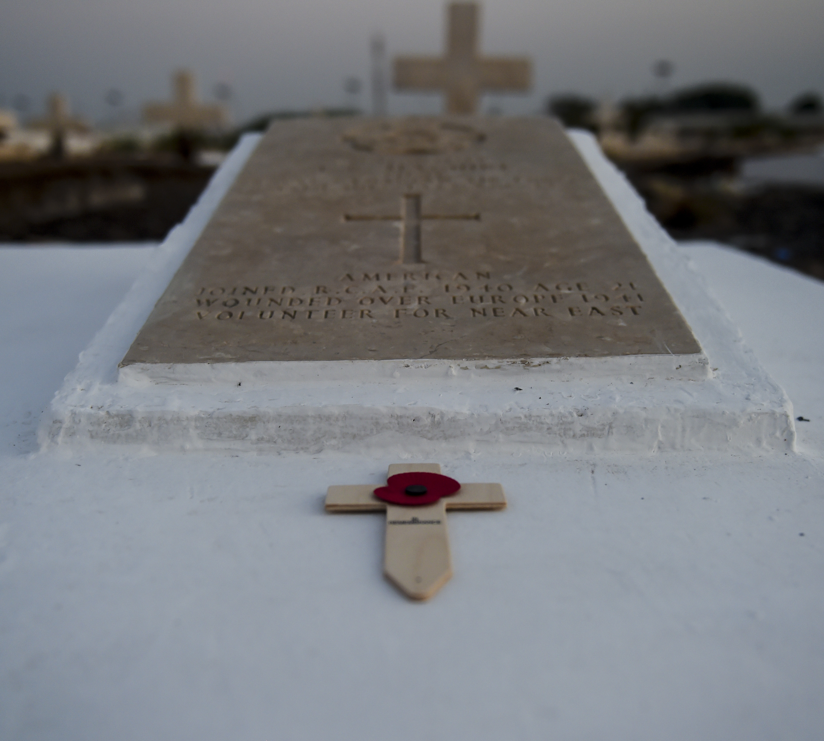 A cross with a poppy lies on grave of former Royal Canadian Air Force Pilot Lawrence Maguire during a Remembrance Day ceremony at the Djibouti New European Cemetery near Camp Lemonnier, Djibouti, Nov. 7, 2017. Maguire was the first member of the RCAF who was killed in action in the African theater of operations and was one of thousands of Americans who volunteered to fight for the RCAF in World War II before the U.S. officially entered the war. Remembrance Day is held annually in honor of the military men and women who have lost their lives in the line of duty. (U.S. Air Force photo by Staff Sgt. Timothy Moore)