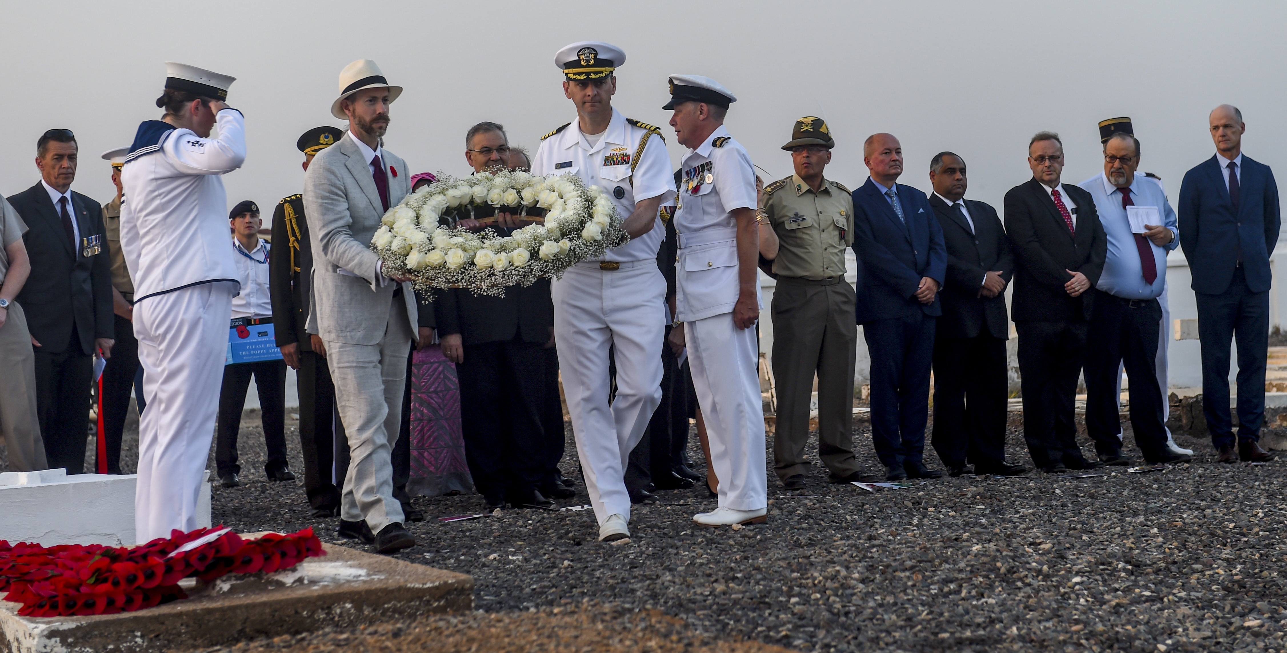 J. Alexander Hamilton (left), Deputy Chief of Mission of U.S. Embassy to the Republic of Djibouti, and U.S. Navy Capt. John Tully, senior defense official and defense attaché, walk to lay a wreath during a Remembrance Day ceremony at the Djibouti New European Cemetery near Camp Lemonnier, Djibouti, Nov. 7, 2017. Service members from Combined Joint Task Force - Horn of Africa joined other representatives of the United States, the United Kingdom, Russia, the Commonwealth, and the European Union as they honored service members who gave their lives during wartime. (U.S. Air Force photo by Staff Sgt. Timothy Moore)